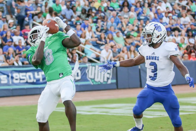 UWF receiver Ezra Safford (8), one of the Argos many transfer players with impact, makes a circus-like touchdown catch in the Sept. 15 game against Shorter.
