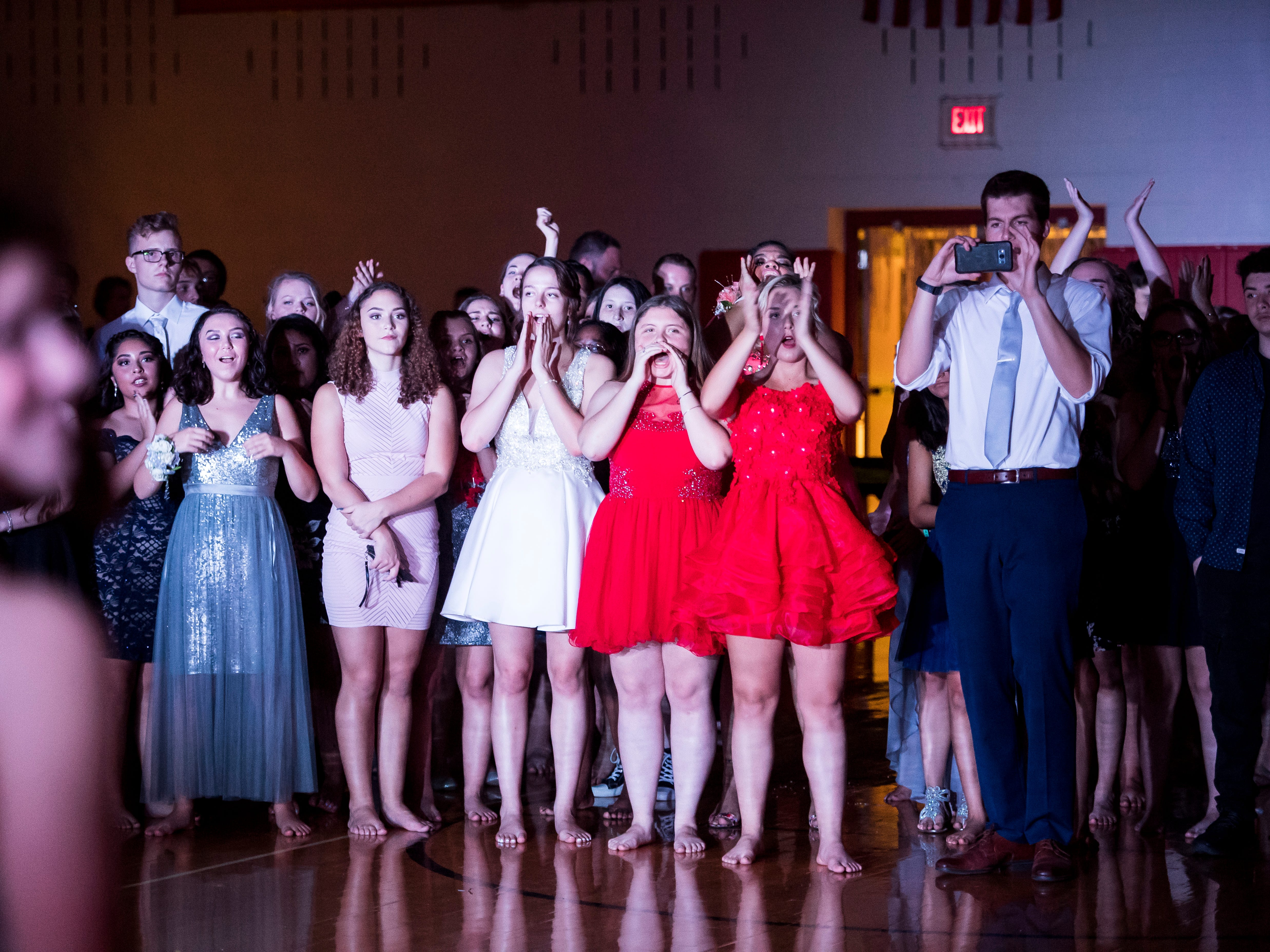 The student body cheers as the Hanover High School homecoming court is introduced on Saturday, September 15, 2018.