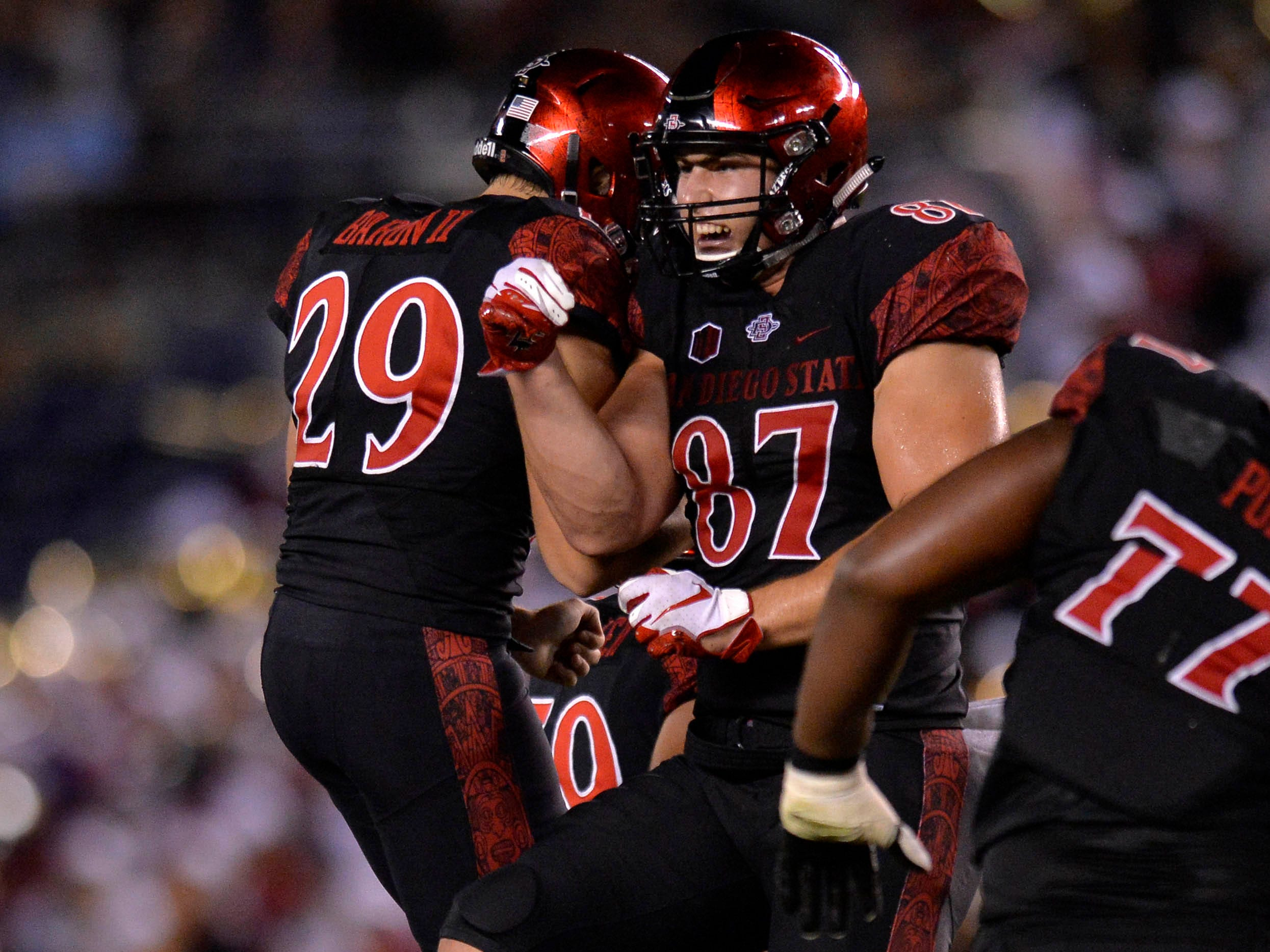 Sep 15, 2018; San Diego, CA, USA; San Diego State Aztecs place kicker John Baron II (29) and tight end Kahale Warring (87) celebrate after Baron II made a 54 yard field goal in the third quarter against the Arizona State Sun Devils at SDCCU Stadium. Mandatory Credit: Jake Roth-USA TODAY Sports