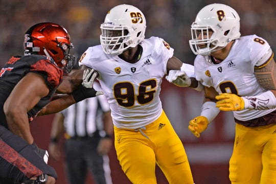 Sep 15, 2018; San Diego, CA, USA; Arizona State Sun Devils defensive lineman Jalen Bates (96) and linebacker Merlin Robertson (8) work agast San Diego State Aztecs offensive lineman Kyle Spalding (71) during the first quarter at SDCCU Stadium. Mandatory Credit: Jake Roth-USA TODAY Sports