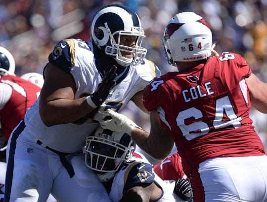 Rams defensive tackle Ndamukong Suh works against Cardinals rookie center Mason Cole during the second half of a game Sunday.