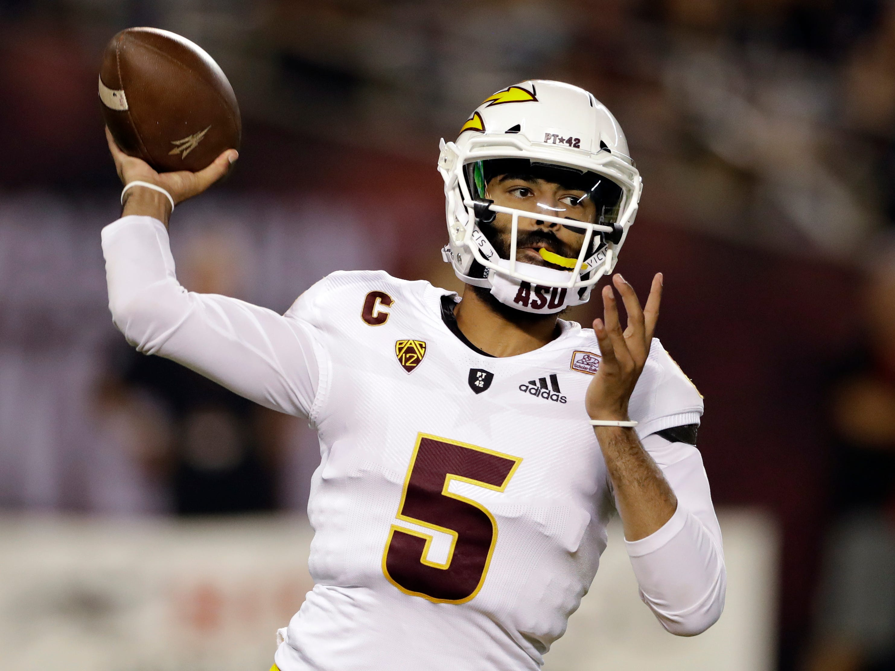 Arizona State quarterback Manny Wilkins throws a pass during the first half of an NCAA college football game against San Diego State, Saturday, Sept. 15, 2018, in San Diego. (AP Photo/Gregory Bull)