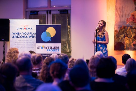 Becca Smouse tells her story during Arizona Storytellers Project presents Searching at the Desert Botanical Garden in Phoenix on Thursday, Sep. 13, 2018.