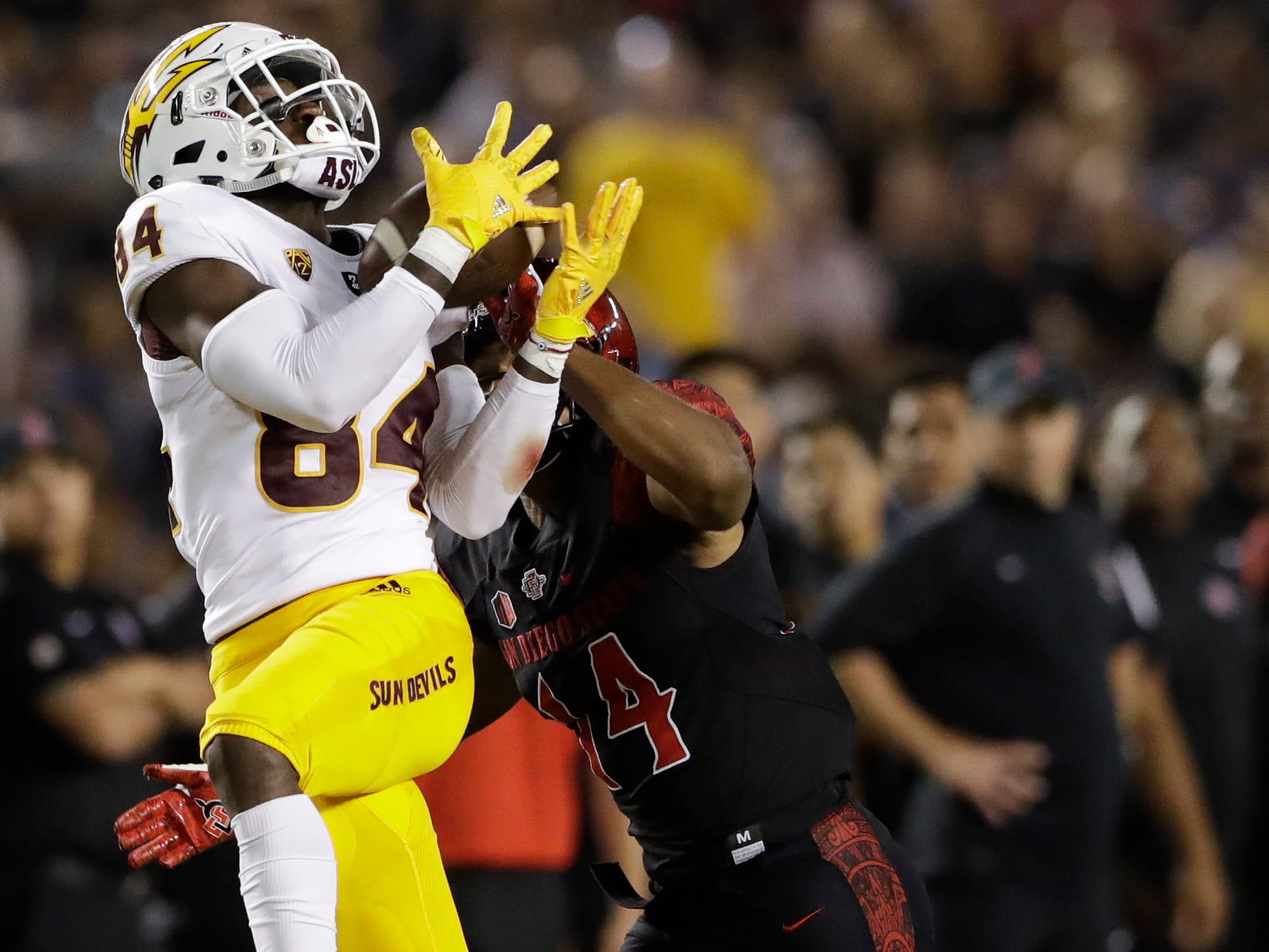 Arizona State wide receiver Tyerell Baldonado-Kaeiopu hauls in a pass as San Diego State safety Tariq Thompson defends during the first half of an NCAA college football game, Saturday, Sept. 15, 2018, in San Diego. (AP Photo/Gregory Bull)