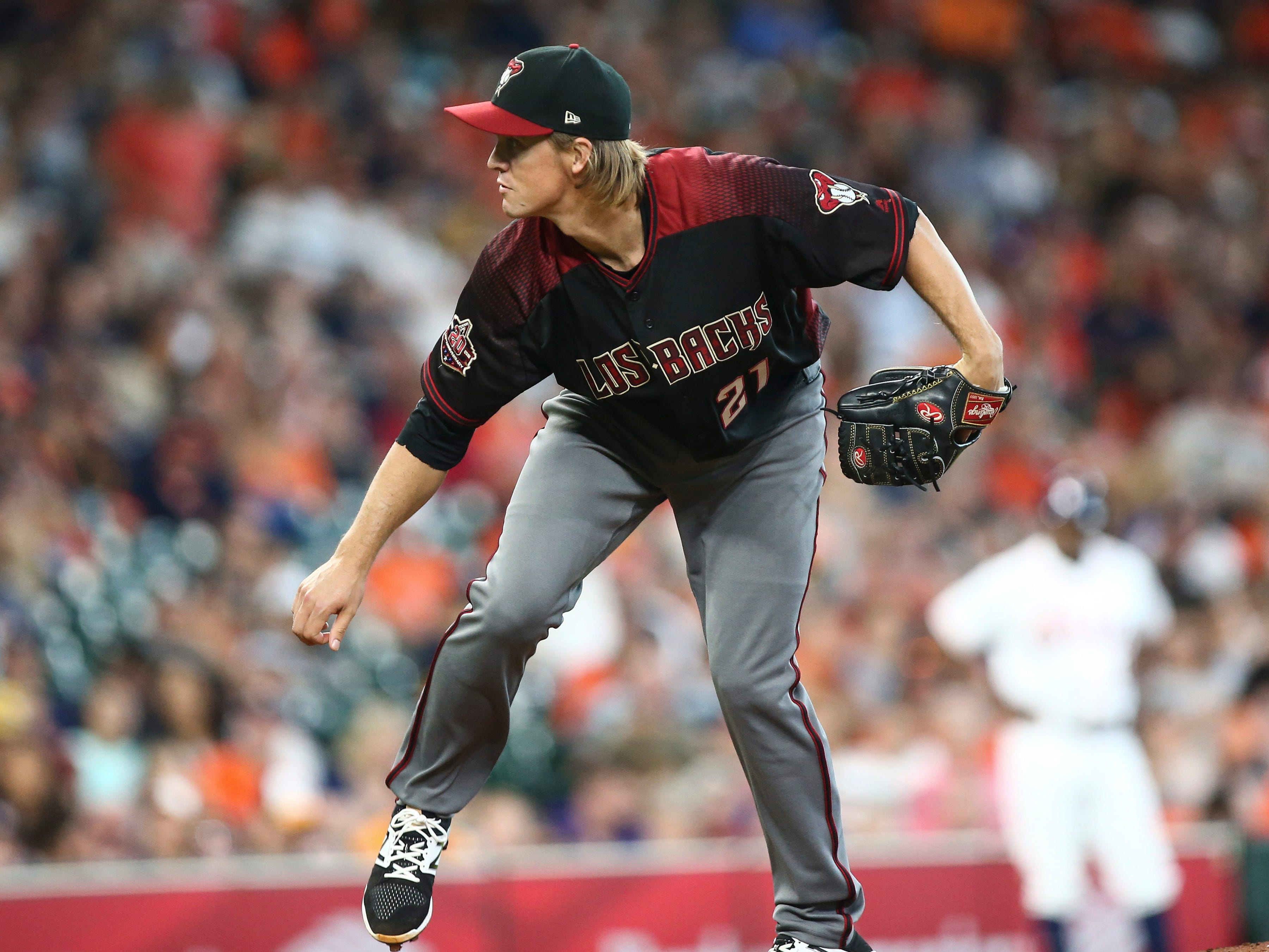 Sep 16, 2018; Houston, TX, USA; Arizona Diamondbacks starting pitcher Zack Greinke (21) delivers a pitch during the second inning against the Houston Astros at Minute Maid Park. Mandatory Credit: Troy Taormina-USA TODAY Sports