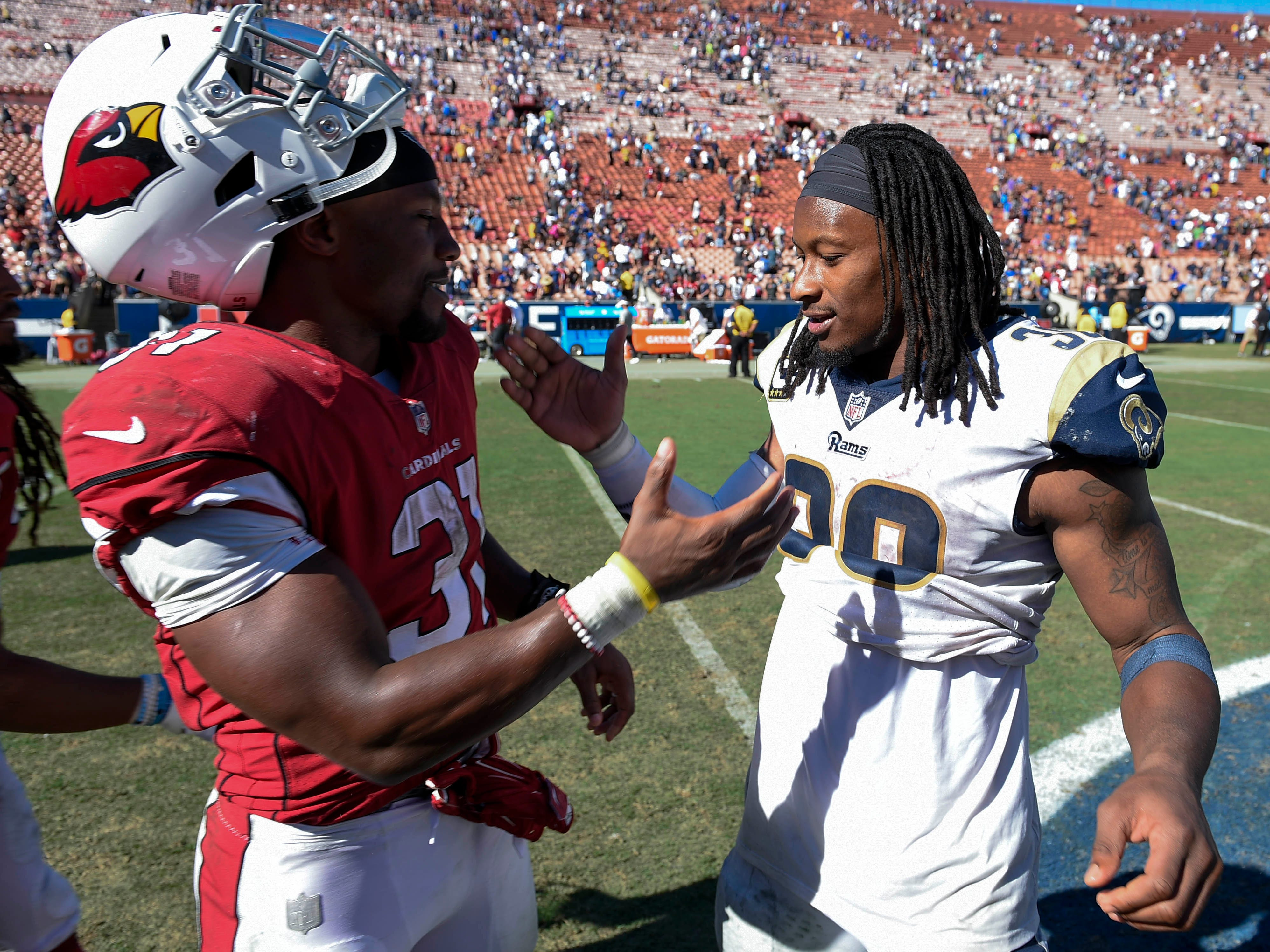 Sep 16, 2018; Los Angeles, CA, USA; Los Angeles Rams running back Todd Gurley II (right) and Arizona Cardinals running back David Johnson (31) meet after the game at Los Angeles Memorial Coliseum. Mandatory Credit: Kelvin Kuo-USA TODAY Sports