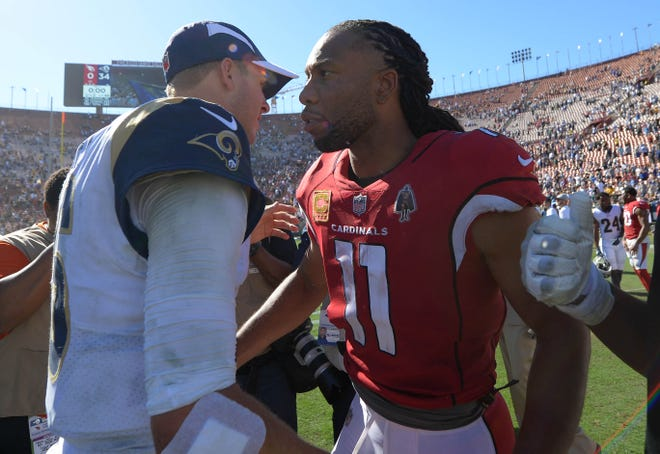 September 16, 2018; Los Angeles, CA, USA; Arizona Cardinals wide receiver Larry Fitzgerald (11) meets with Los Angeles Rams quarterback Jared Goff (16) following the game at the Los Angeles Memorial Coliseum. Mandatory Credit: Gary A. Vasquez-USA TODAY Sports