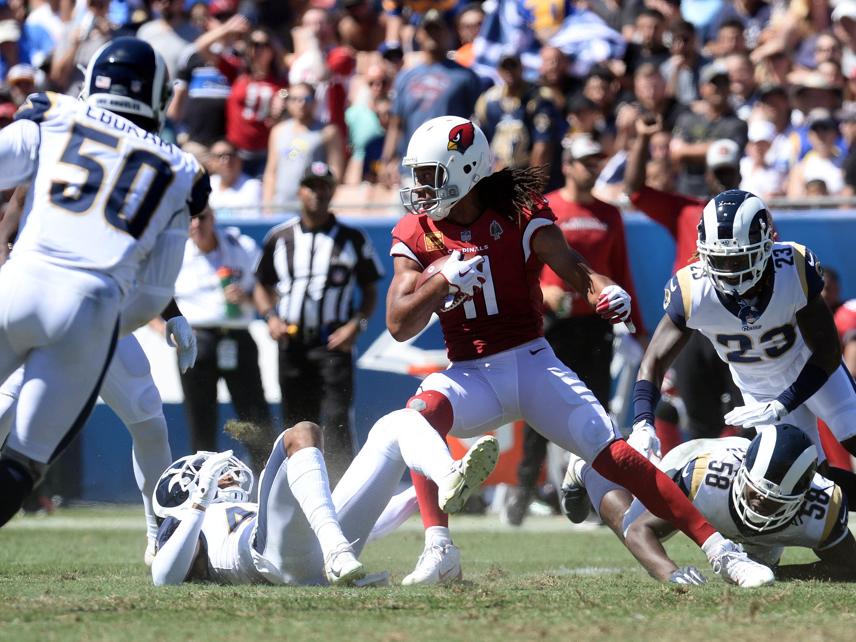 September 16, 2018; Los Angeles, CA, USA; Arizona Cardinals wide receiver Larry Fitzgerald (11) runs the ball against the Los Angeles Rams during the first half at the Los Angeles Memorial Coliseum. Mandatory Credit: Gary A. Vasquez-USA TODAY Sports