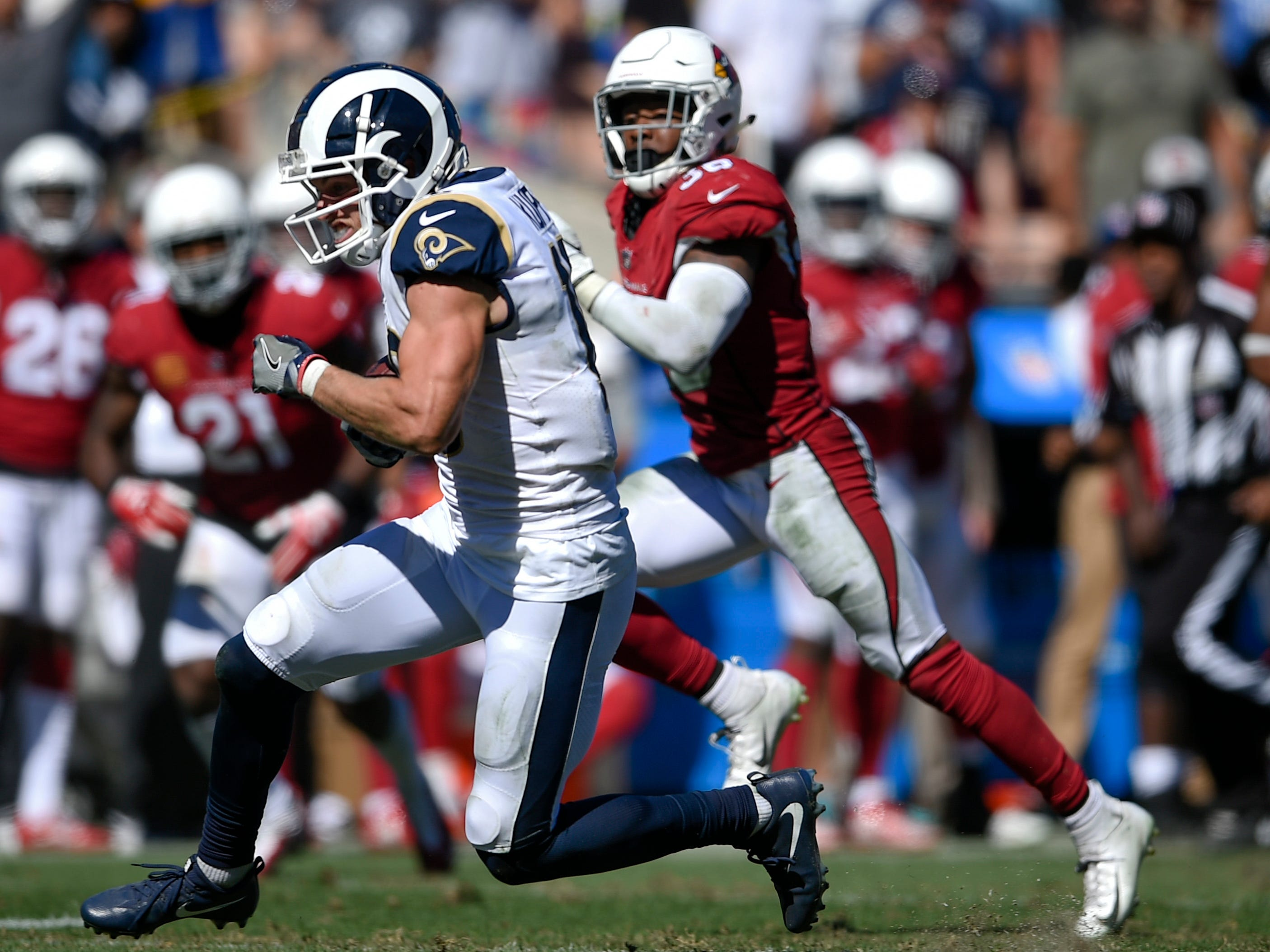 Sep 16, 2018; Los Angeles, CA, USA; Los Angeles Rams wide receiver Cooper Kupp (18) runs after a catch against the Arizona Cardinals during the second half at Los Angeles Memorial Coliseum. Mandatory Credit: Kelvin Kuo-USA TODAY Sports