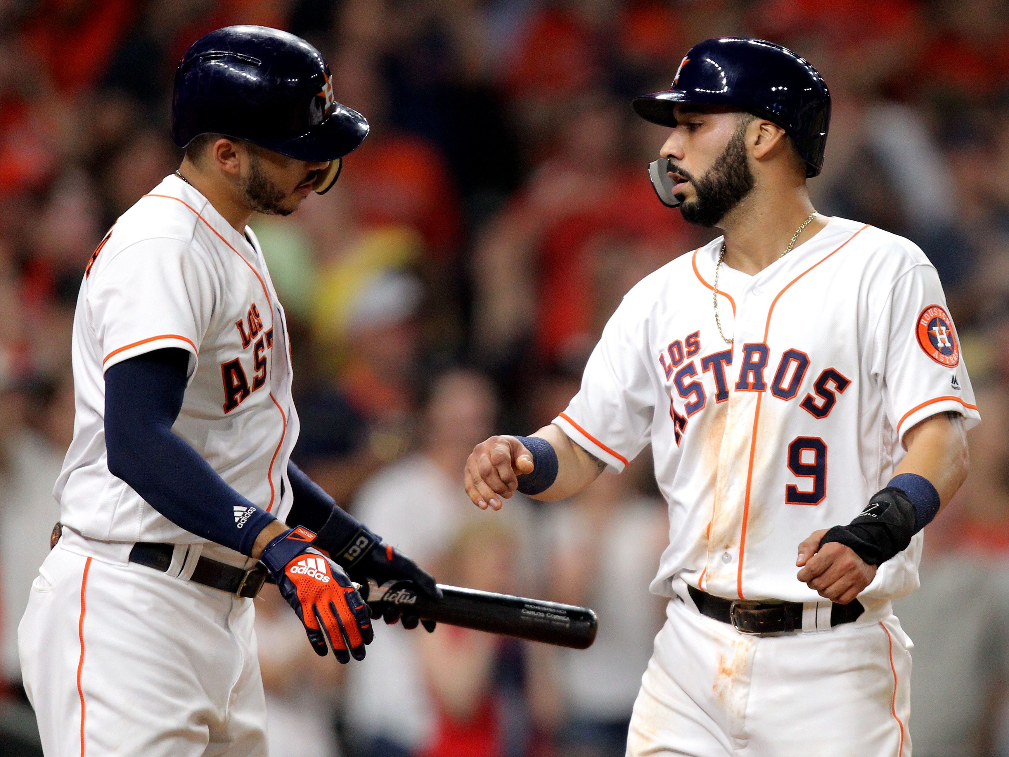 Sep 15, 2018; Houston, TX, USA; Houston Astros left fielder Marwin Gonzalez (9, right) is congratulated by Houston Astros shortstop Carlos Correa (1) after scoring a run against the Arizona Diamondbacks during the fourth inning at Minute Maid Park. Mandatory Credit: Erik Williams-USA TODAY Sports