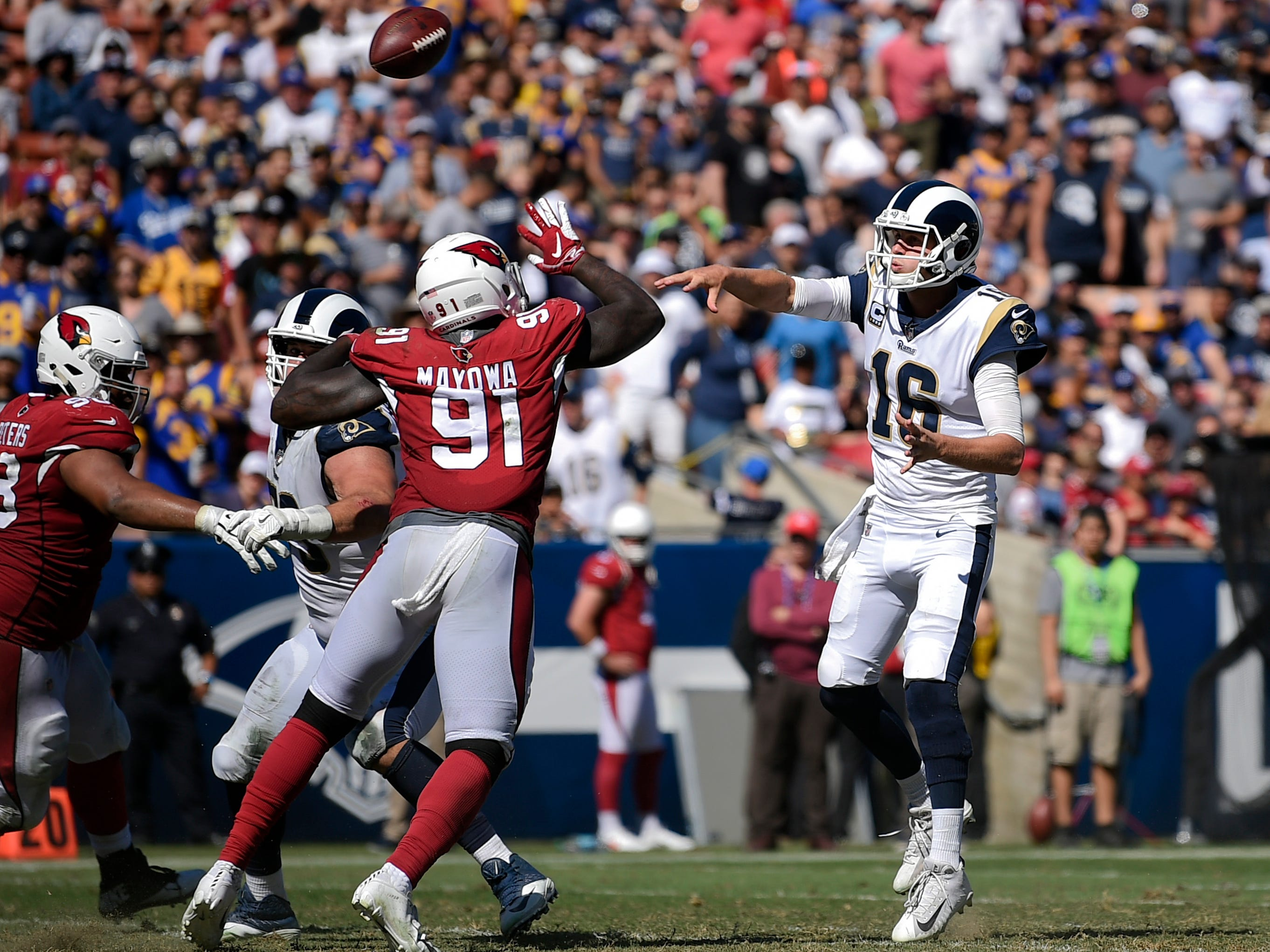 Sep 16, 2018; Los Angeles, CA, USA; Los Angeles Rams quarterback Jared Goff (16) passes for a two-point conversion during the second half against the Arizona Cardinals at Los Angeles Memorial Coliseum. Mandatory Credit: Kelvin Kuo-USA TODAY Sports