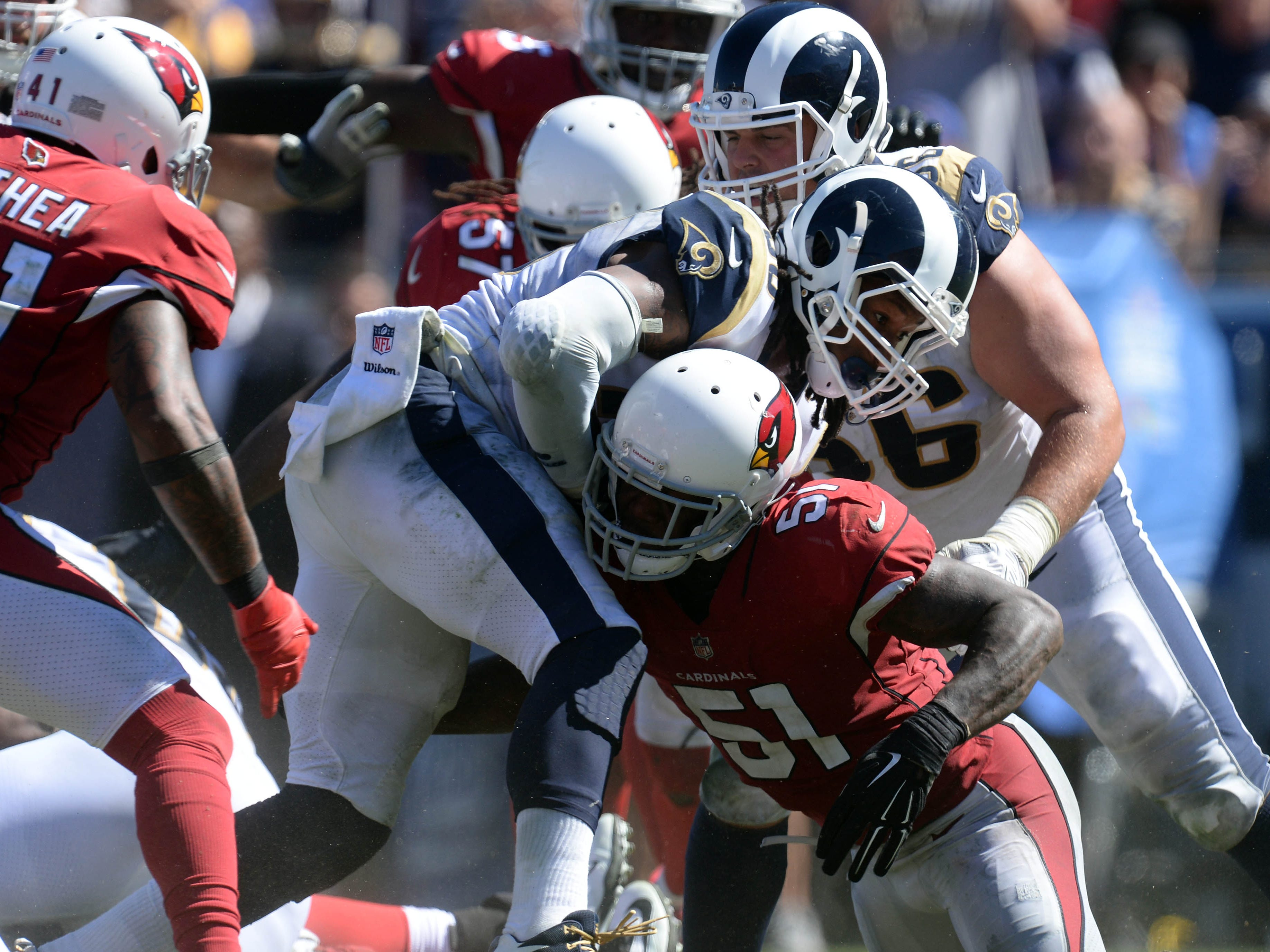 September 16, 2018; Los Angeles, CA, USA; Los Angeles Rams running back Todd Gurley (30) runs the ball against the defense of Arizona Cardinals linebacker Gerald Hodges (51) during the second half at the Los Angeles Memorial Coliseum. Mandatory Credit: Gary A. Vasquez-USA TODAY Sports