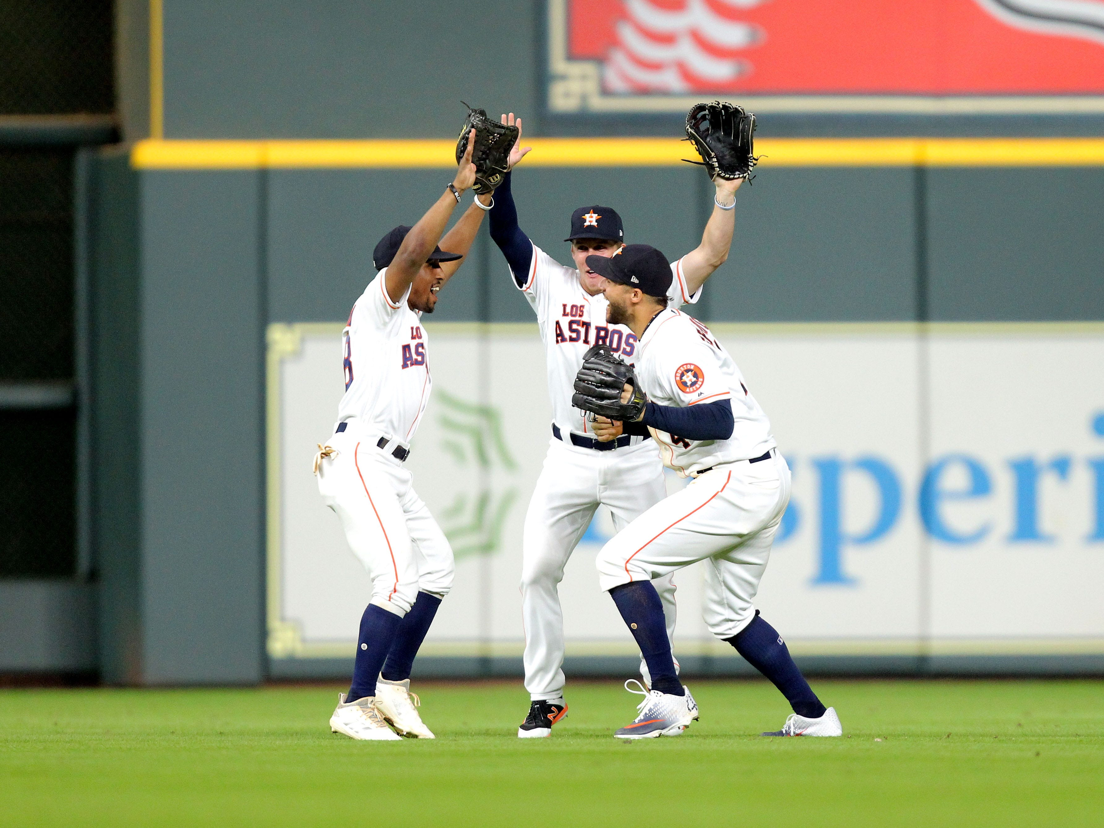 Sep 15, 2018; Houston, TX, USA; The Houston Astros outfielders celebrate after the final out of Houston's 10-4 win over the Arizona Diamondbacks at Minute Maid Park. Mandatory Credit: Erik Williams-USA TODAY Sports