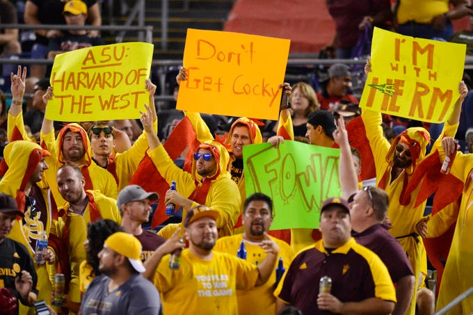 Sep 15, 2018; San Diego, CA, USA; Arizona State Sun Devils fans hold up signs during the third quarter against the Arizona State Sun Devils at SDCCU Stadium. Mandatory Credit: Jake Roth-USA TODAY Sports