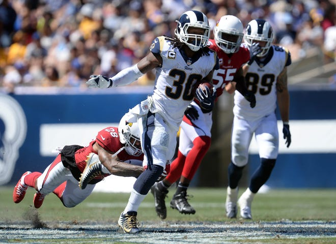September 16, 2018; Los Angeles, CA, USA; Los Angeles Rams running back Todd Gurley (30) runs the ball against the Arizona Cardinals during the first half at the Los Angeles Memorial Coliseum. Mandatory Credit: Gary A. Vasquez-USA TODAY Sports