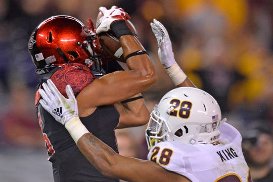 Sep 15, 2018; San Diego, CA, USA; San Diego State Aztecs wide receiver Tim Wilson Jr. (6) catches a touchdown against Arizona State Sun Devils defensive back Demonte King (28) during the second quarter at SDCCU Stadium. Mandatory Credit: Jake Roth-USA TODAY Sports