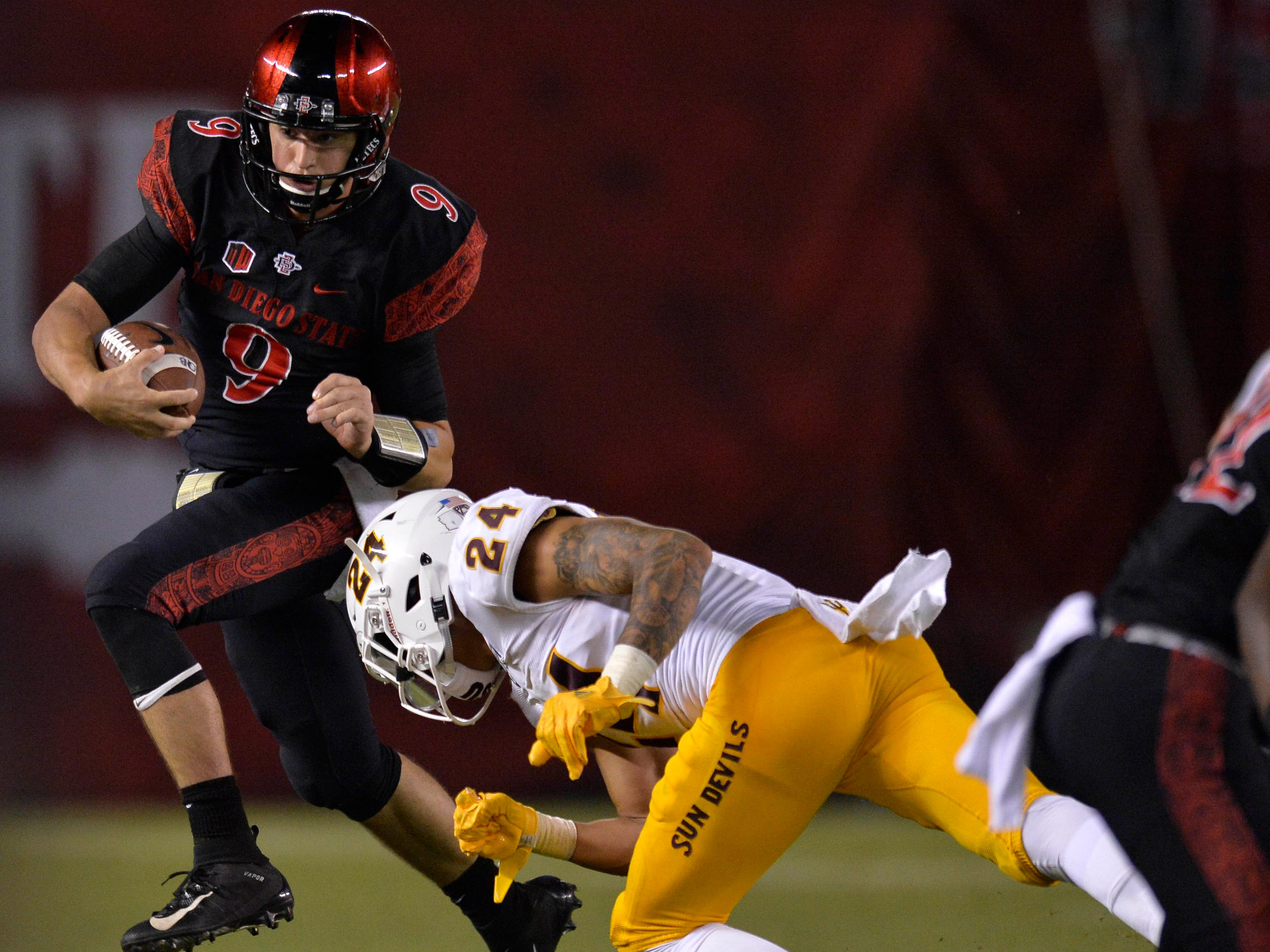 Sep 15, 2018; San Diego, CA, USA; San Diego State Aztecs quarterback Ryan Agnew (9) is tackled by Arizona State Sun Devils defensive back Chase Lucas (24) during the third quarter at SDCCU Stadium. Mandatory Credit: Jake Roth-USA TODAY Sports