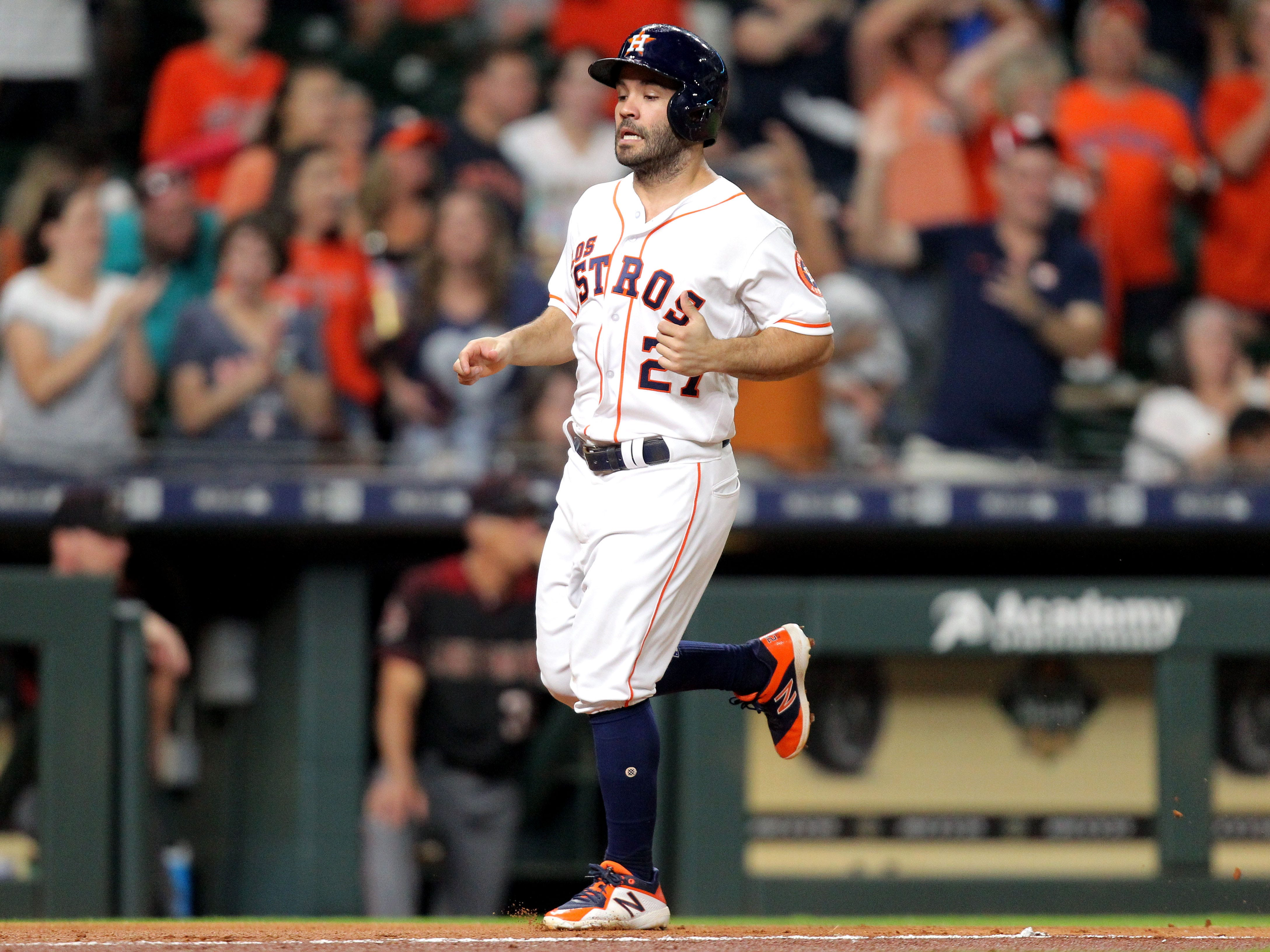 Sep 15, 2018; Houston, TX, USA; Houston Astros second baseman Jose Altuve (27) jogs home to score a run against the Arizona Diamondbacks during the fourth inning at Minute Maid Park. Mandatory Credit: Erik Williams-USA TODAY Sports