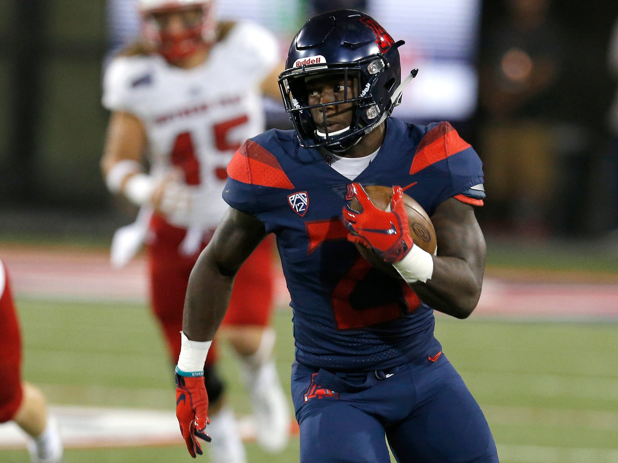 Arizona running back J.J. Taylor (21) in the first half during an NCAA college football game against Southern Utah, Saturday, Sept. 15, 2018, in Tucson, Ariz. (AP Photo/Rick Scuteri)