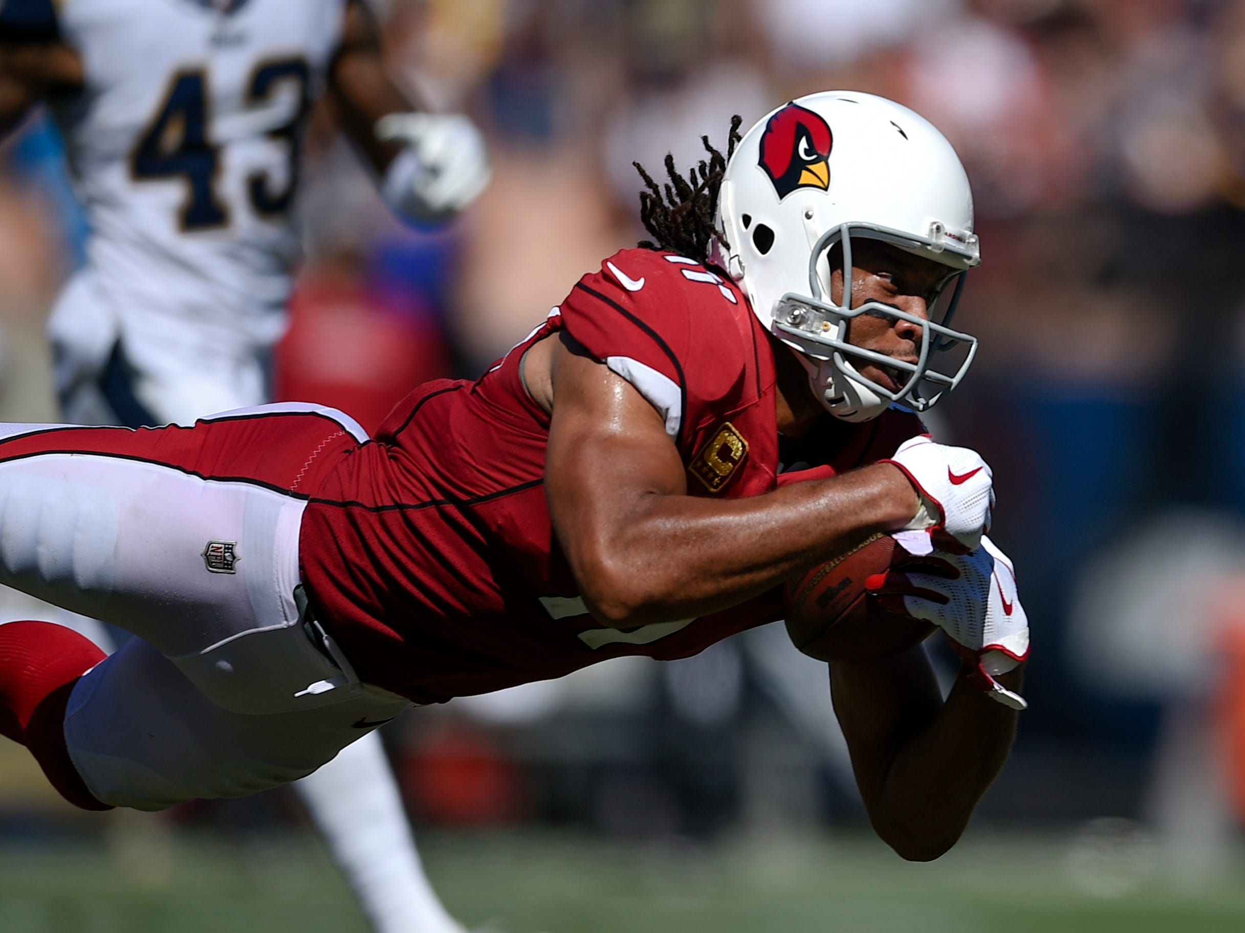 Sep 16, 2018; Los Angeles, CA, USA; Arizona Cardinals wide receiver Larry Fitzgerald (11) catches a pass against the Los Angeles Rams during the second half at Los Angeles Memorial Coliseum. Mandatory Credit: Kelvin Kuo-USA TODAY Sports