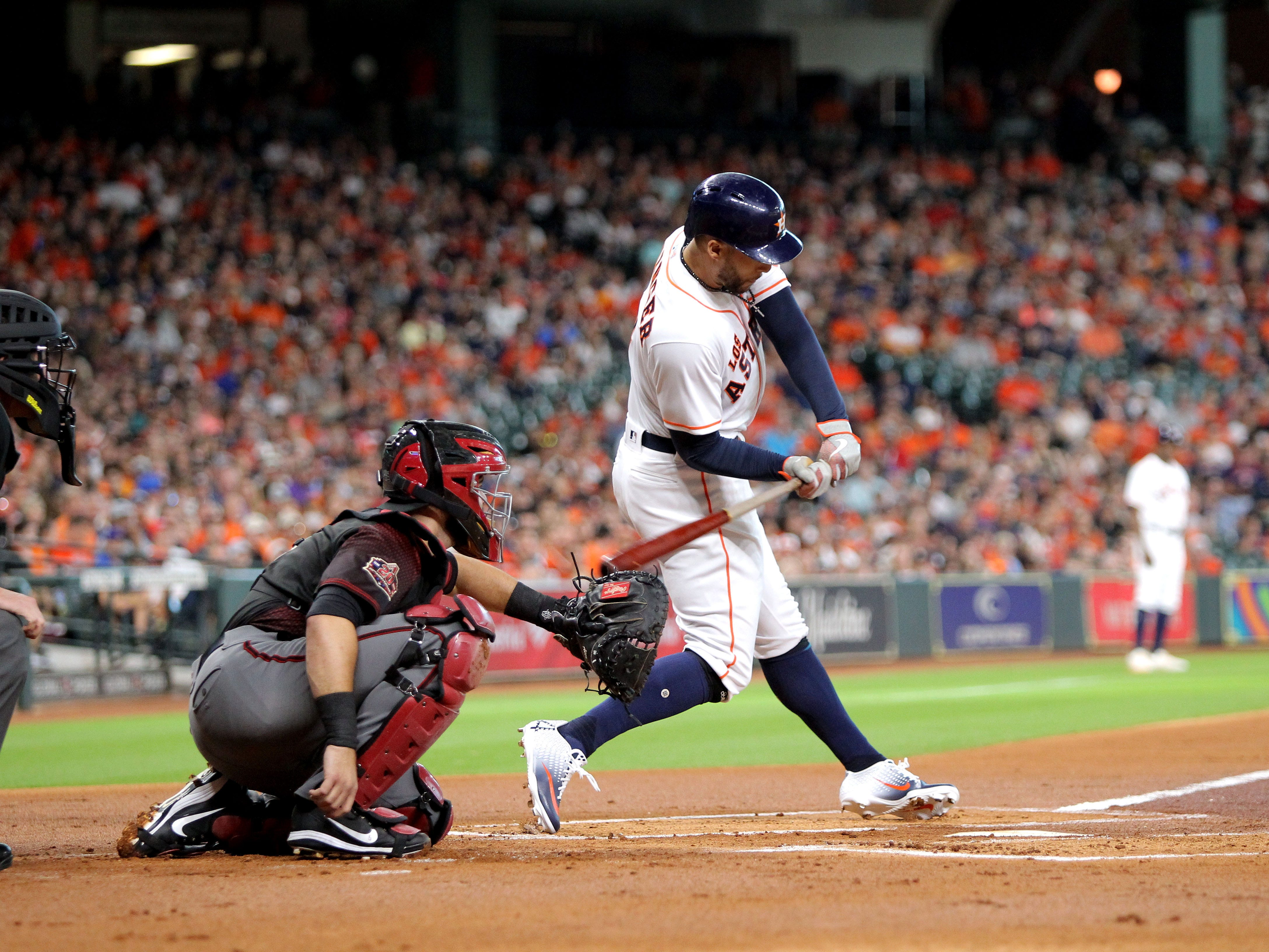 Sep 15, 2018; Houston, TX, USA; Houston Astros center fielder George Springer (4) hits a single to left field against the Arizona Diamondbacks during the first inning at Minute Maid Park. Mandatory Credit: Erik Williams-USA TODAY Sports