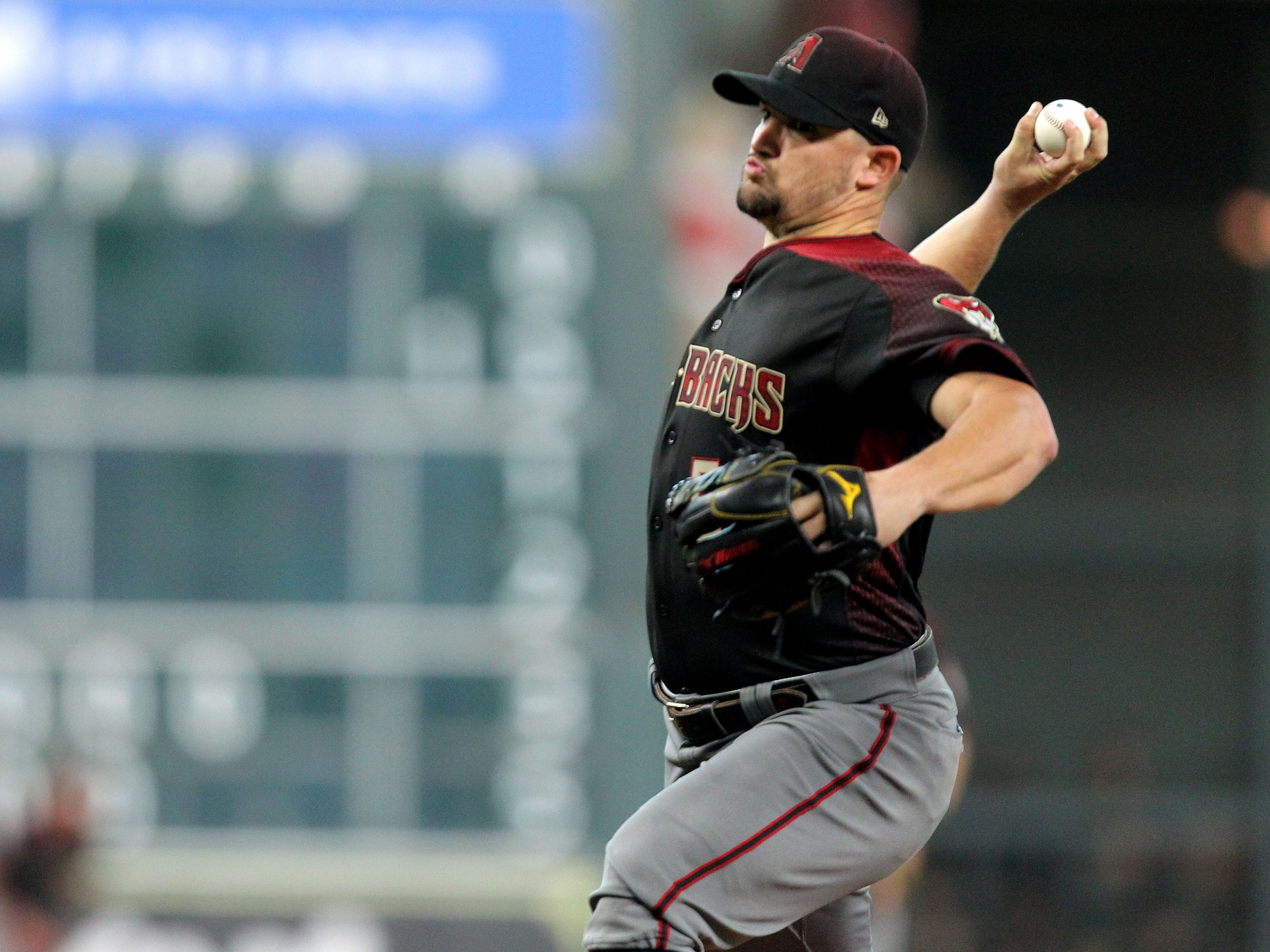 Sep 15, 2018; Houston, TX, USA; Arizona Diamondbacks starting pitcher Zack Godley (52) delivers a pitch against the Houston Astros during the first inning at Minute Maid Park. Mandatory Credit: Erik Williams-USA TODAY Sports