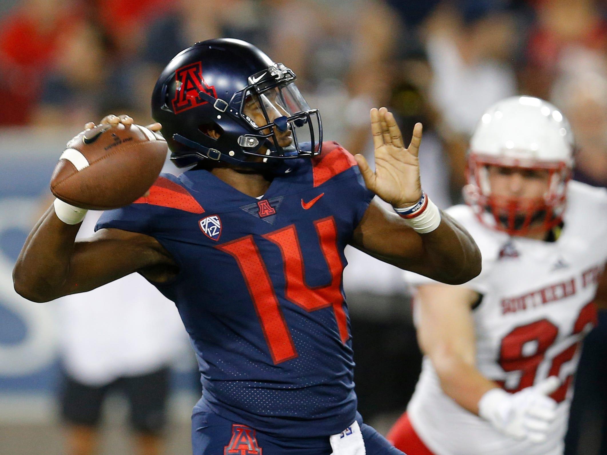 Arizona quarterback Khalil Tate (14) throws downfield against Southern Utah in the first half during an NCAA college football game, Saturday, Sept. 15, 2018, in Tucson, Ariz. (AP Photo/Rick Scuteri)