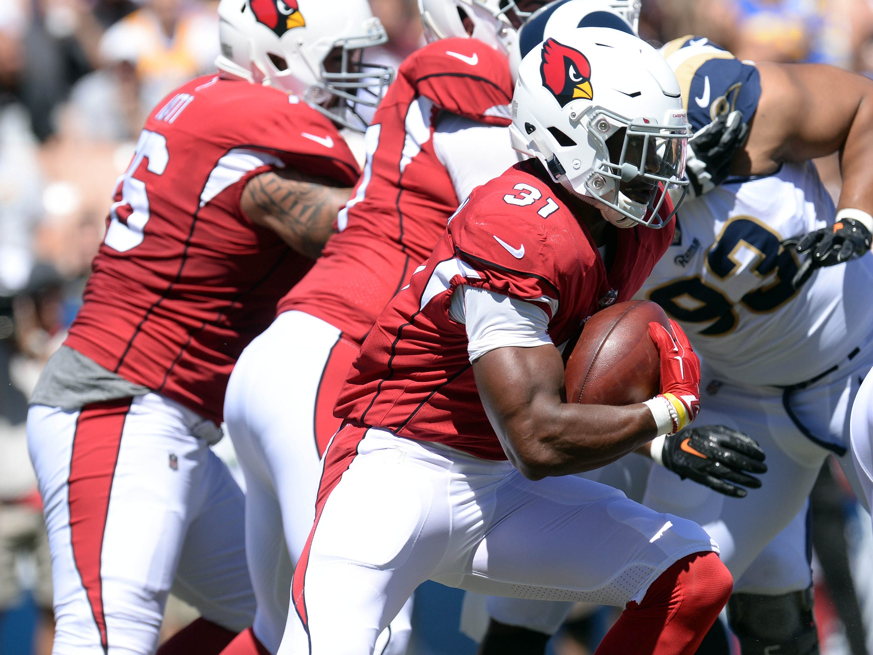 September 16, 2018; Los Angeles, CA, USA; Arizona Cardinals running back David Johnson (31) runs the ball against the Los Angeles Rams during the first half at the Los Angeles Memorial Coliseum. Mandatory Credit: Gary A. Vasquez-USA TODAY Sports
