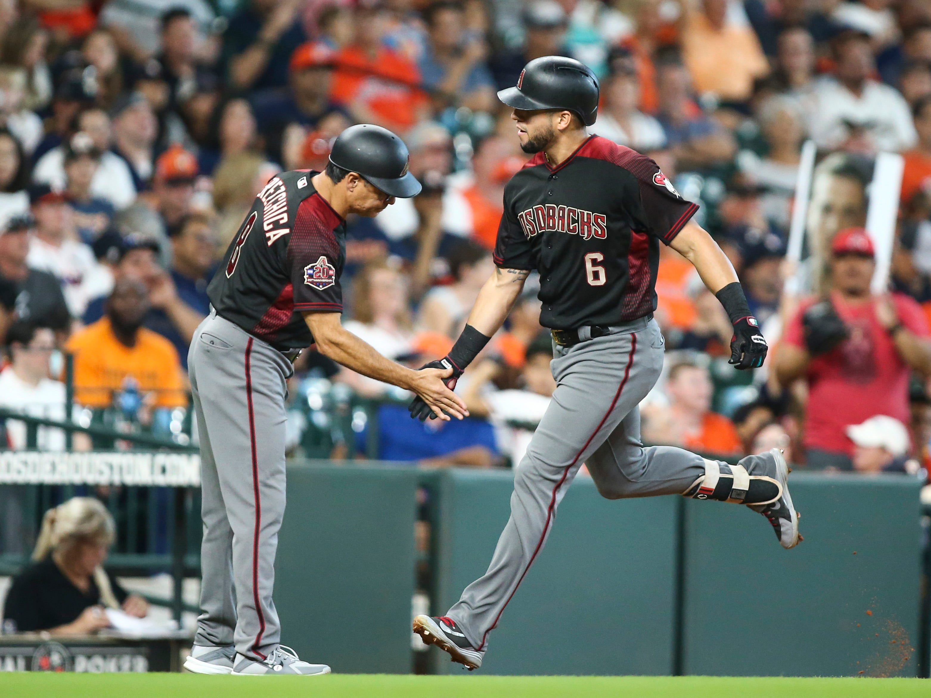 Sep 16, 2018; Houston, TX, USA; Arizona Diamondbacks left fielder David Peralta (6) celebrates with third base coach Tony Perezchica (8) after hitting a home run during the sixth inning against the Houston Astros at Minute Maid Park. Mandatory Credit: Troy Taormina-USA TODAY Sports