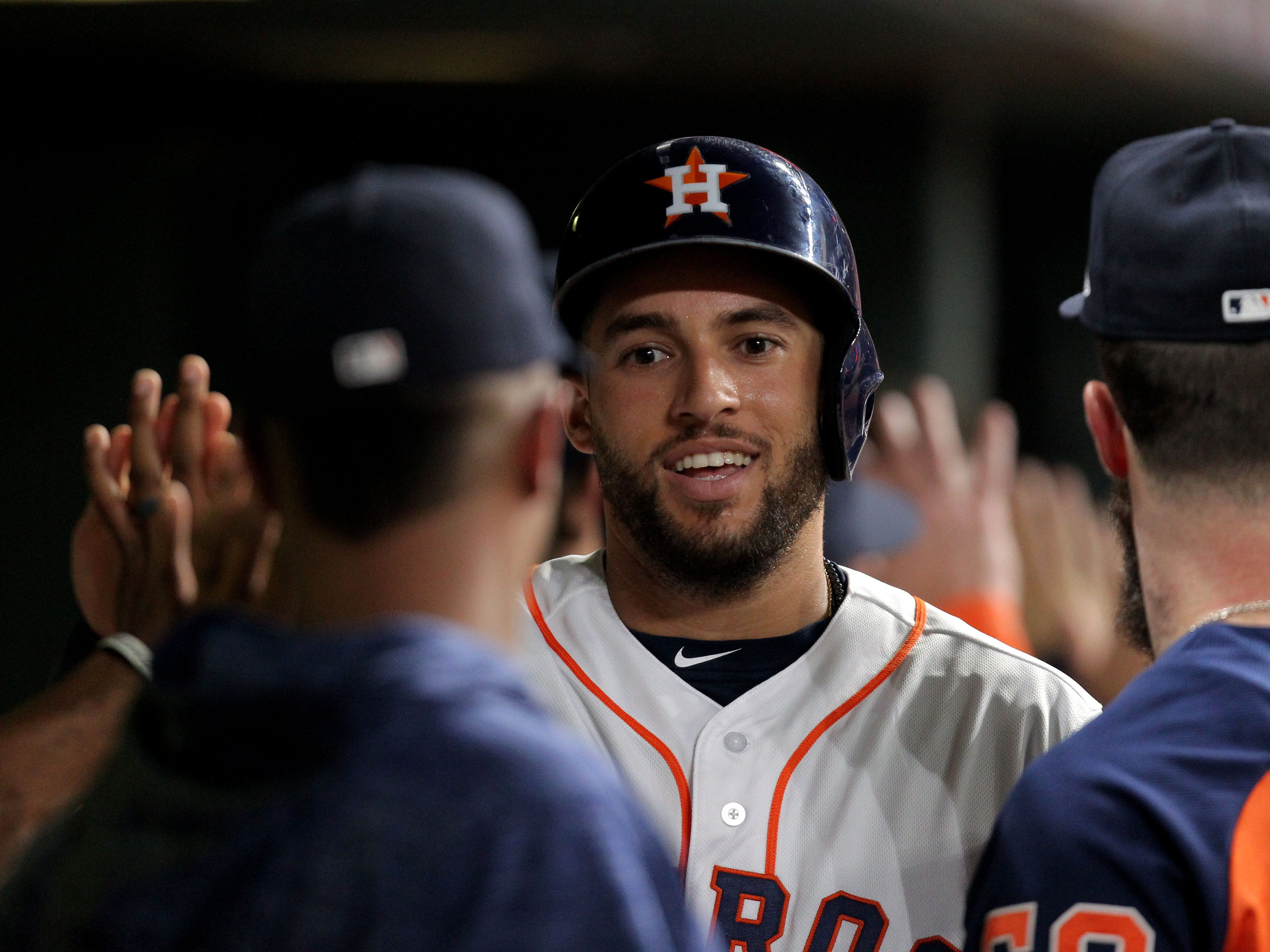 Sep 15, 2018; Houston, TX, USA; Houston Astros center fielder George Springer (4) is greeted in the dugout after scoring a run against the Arizona Diamondbacks during the fourth inning at Minute Maid Park. Mandatory Credit: Erik Williams-USA TODAY Sports
