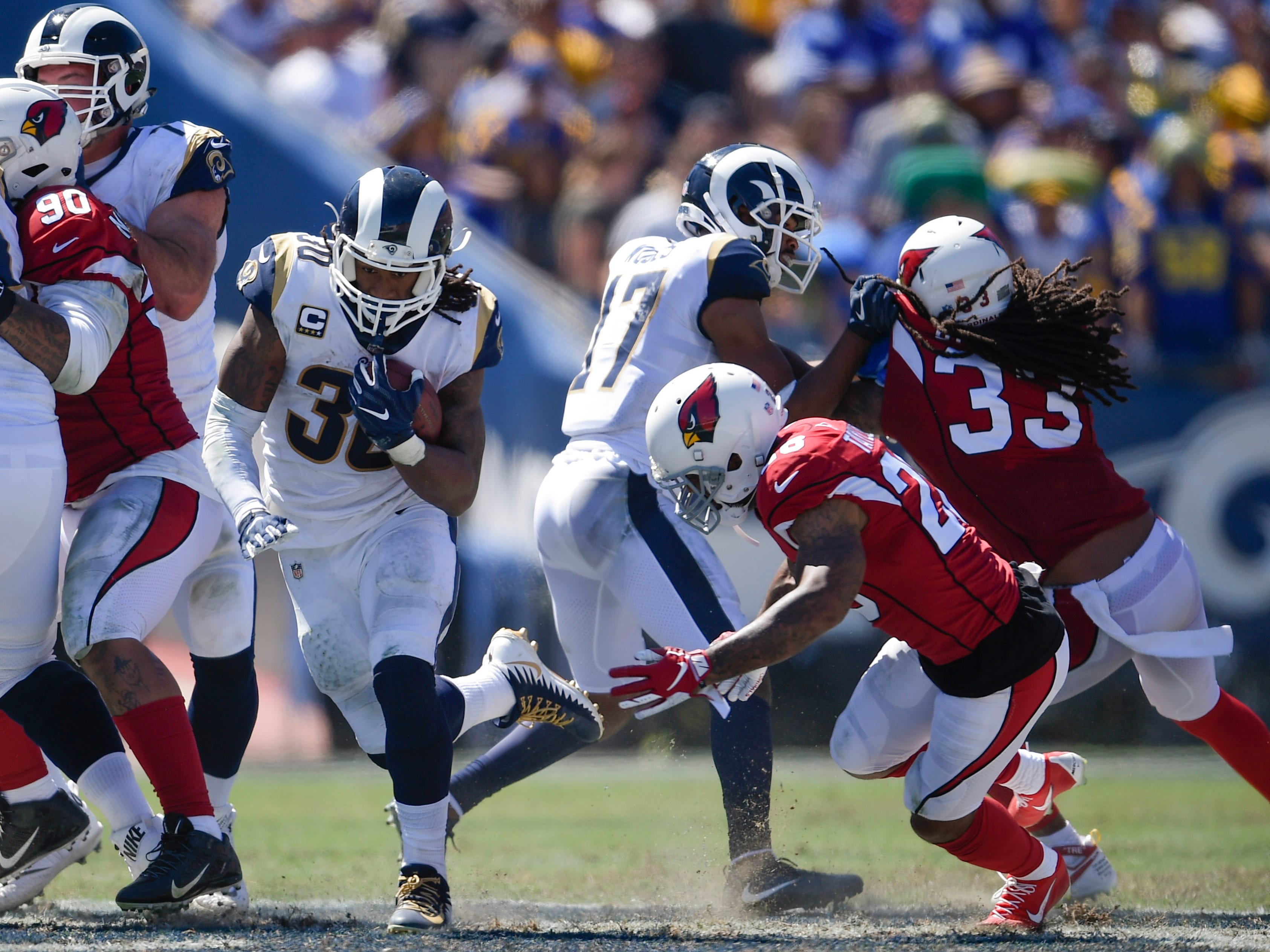 Sep 16, 2018; Los Angeles, CA, USA; Los Angeles Rams running back Todd Gurley II (30) runs the ball during the first half against the Arizona Cardinals at Los Angeles Memorial Coliseum. Mandatory Credit: Kelvin Kuo-USA TODAY Sports