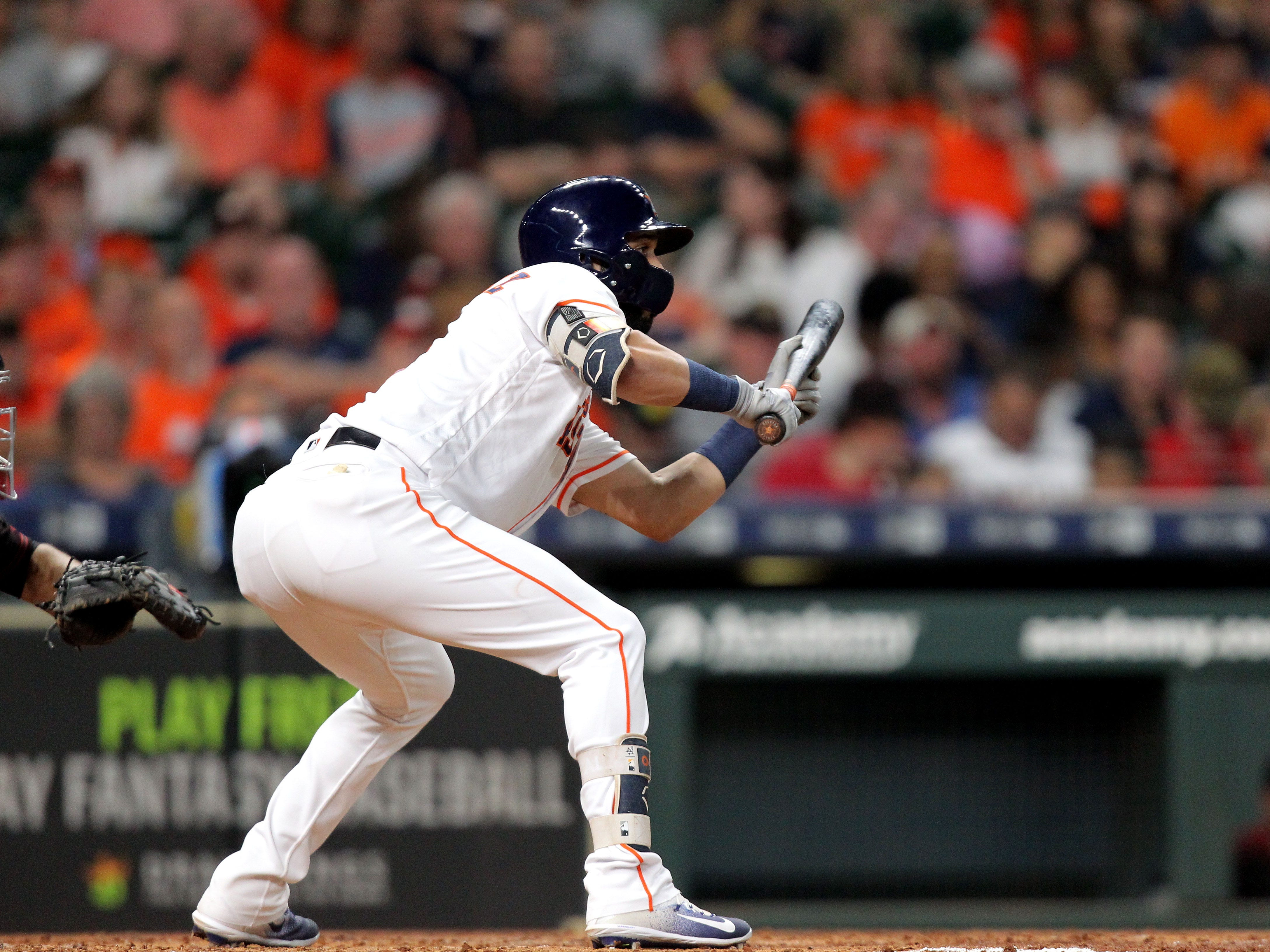Sep 15, 2018; Houston, TX, USA; Houston Astros left fielder Marwin Gonzalez (9) looks to lay down a bunt against the Arizona Diamondbacks during the third inning at Minute Maid Park. Mandatory Credit: Erik Williams-USA TODAY Sports