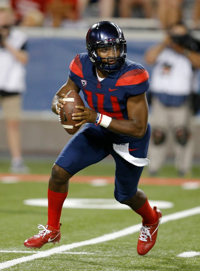 Arizona quarterback Khalil Tate (14) in the first half during an NCAA college football game against Southern Utah, Saturday, Sept. 15, 2018, in Tucson, Ariz. (AP Photo/Rick Scuteri)