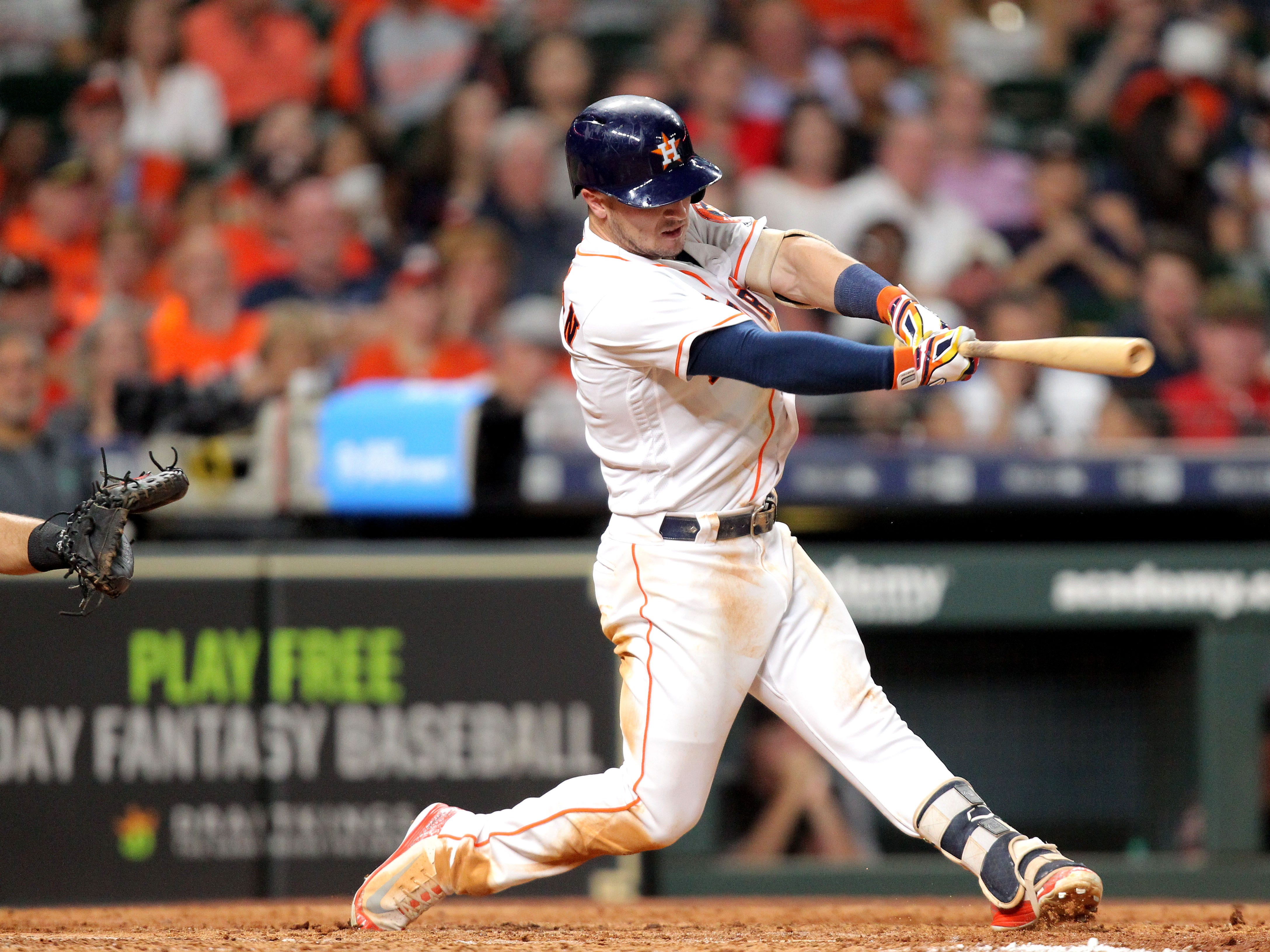 Sep 15, 2018; Houston, TX, USA; Houston Astros third baseman Alex Bregman (2) hits an RBI infield single against the Arizona Diamondbacks during the sixth inning at Minute Maid Park. Mandatory Credit: Erik Williams-USA TODAY Sports