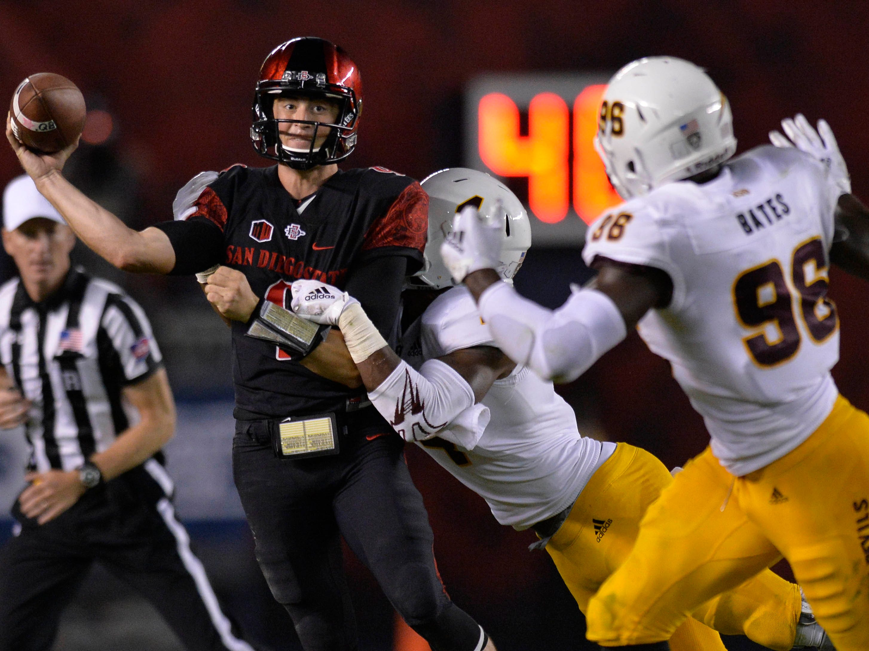 Sep 15, 2018; San Diego, CA, USA; San Diego State Aztecs quarterback Ryan Agnew (9) throws as Arizona State Sun Devils linebacker Koron Crump (4) pressures during the third quarter at SDCCU Stadium. Mandatory Credit: Jake Roth-USA TODAY Sports