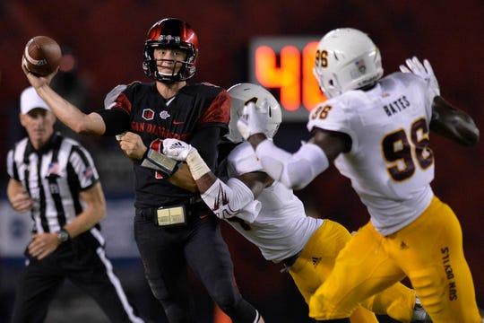 Sep 15, 2018; San Diego, CA, USA; San Diego State Aztecs quarterback Ryan Agnew (9) throws as Arizona State Sun Devils linebacker Koron Crump (4) pressures during the third quarter at SDCCU Stadium. Mandatory Credit: Jake Roth-USA TODAY Sports