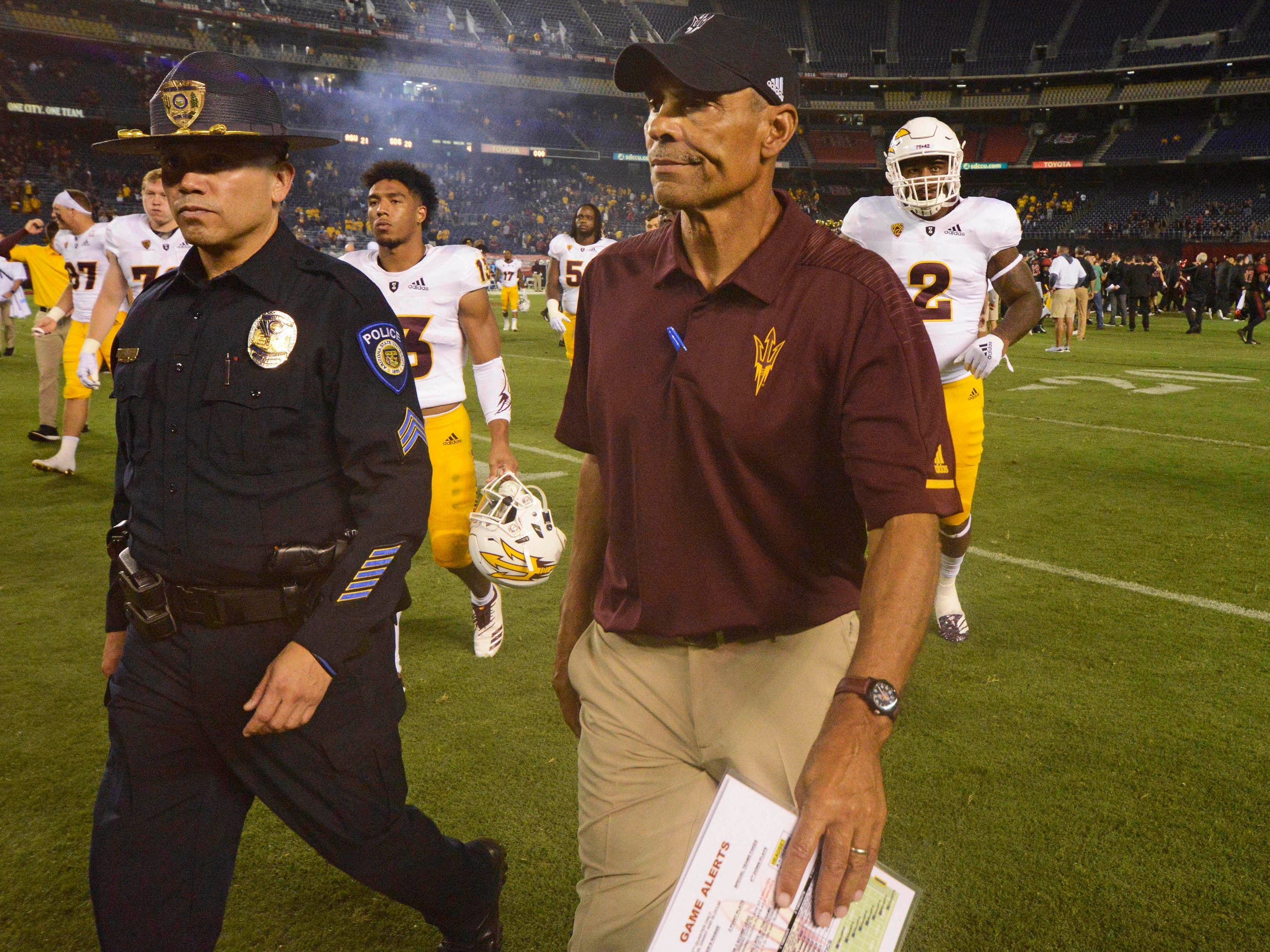 Sep 15, 2018; San Diego, CA, USA; Arizona State Sun Devils head coach Herm Edwards (right) reacts as he walks off the field following a 21-28 loss against the San Diego State Aztecs at SDCCU Stadium. Mandatory Credit: Jake Roth-USA TODAY Sports