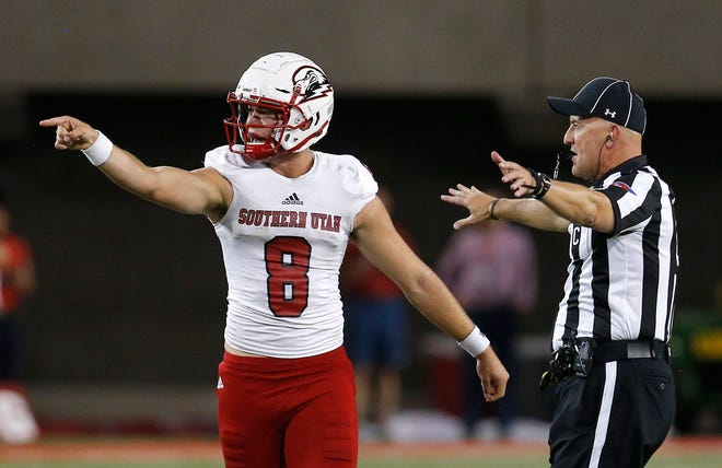 Southern Utah quarterback Chris Helbig (8) reacts after getting hit late by an Arizona defenseman in the first half during an NCAA college football game, Saturday, Sept. 15, 2018, in Tucson, Ariz. (AP Photo/Rick Scuteri)