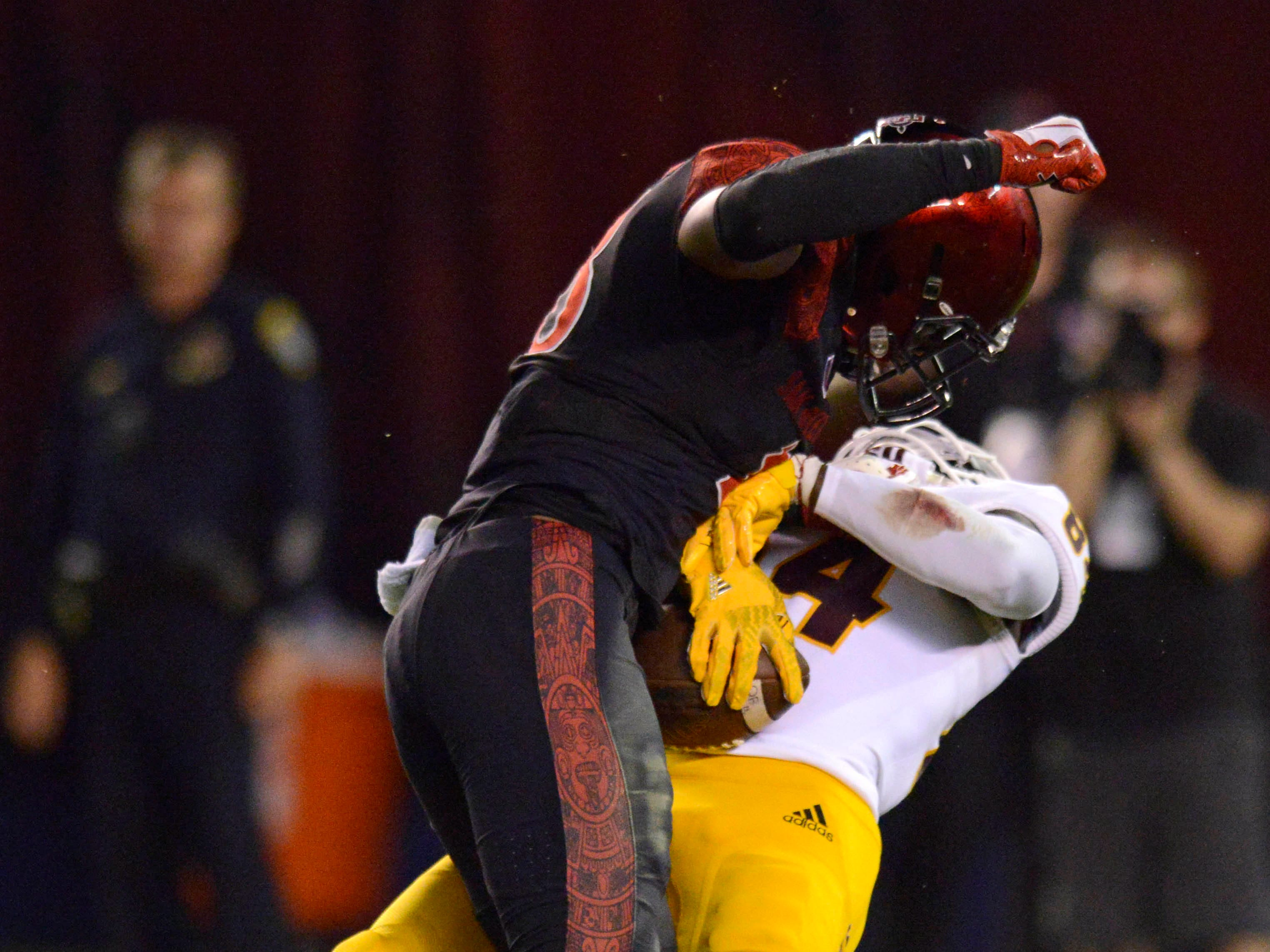 San Diego State Aztecs safety Trenton Thompson (18) hits ASU receiver Frank Darby late in the fourth quarter, a play that was originally ruled a catch until a review overturned the call.