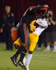 San Diego State safety Trenton Thompson hits ASU receiver Frank Darby late in the fourth quarter, a play that was originally ruled a catch until a review overturned the call.