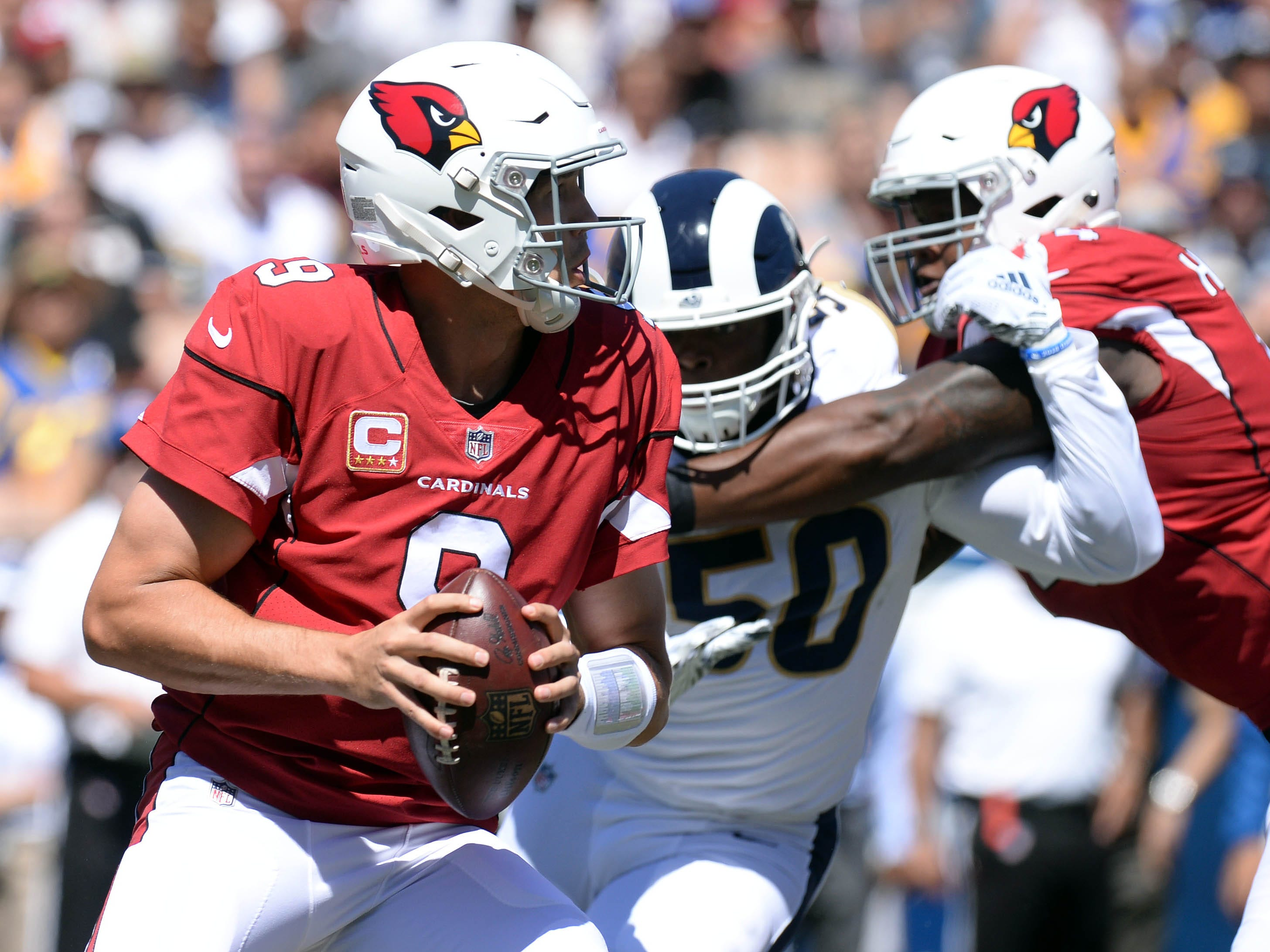 September 16, 2018; Los Angeles, CA, USA; Arizona Cardinals quarterback Sam Bradford (9) drops back to pass as Los Angeles Rams linebacker Samson Ebukam (50) moves in to defend during the first half at the Los Angeles Memorial Coliseum. Mandatory Credit: Gary A. Vasquez-USA TODAY Sports