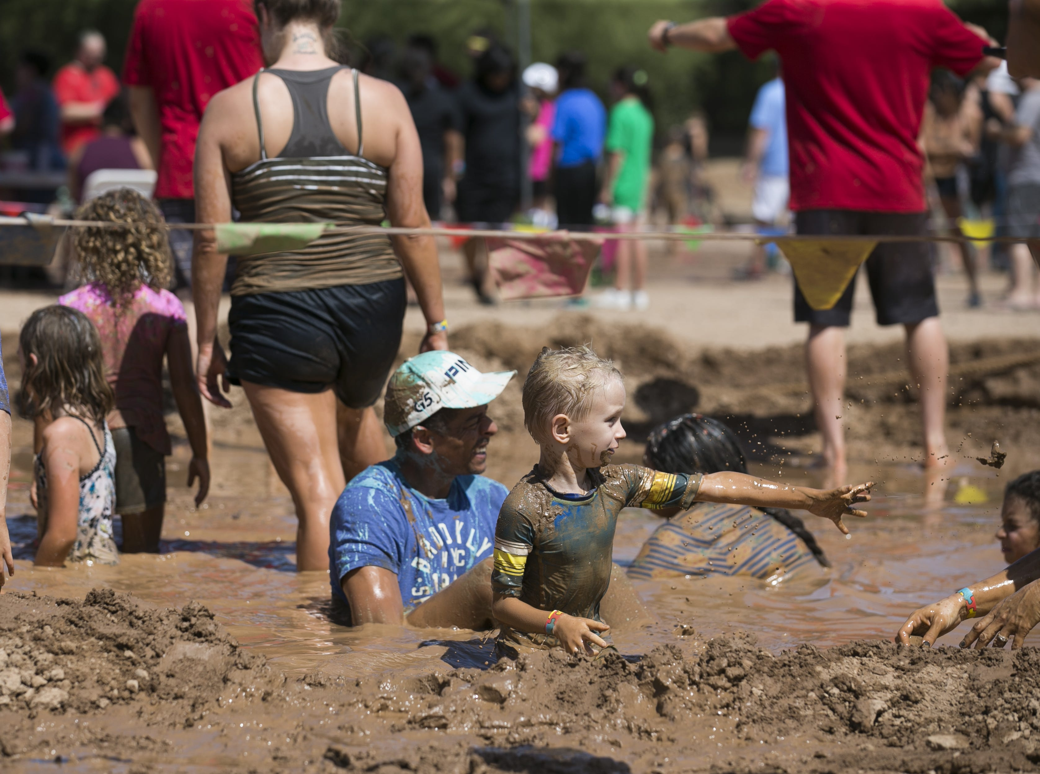 Kids and adults play in a mud pit at the third annual Messy Fest in Queen Creek on Saturday, Sept. 15, 2018.