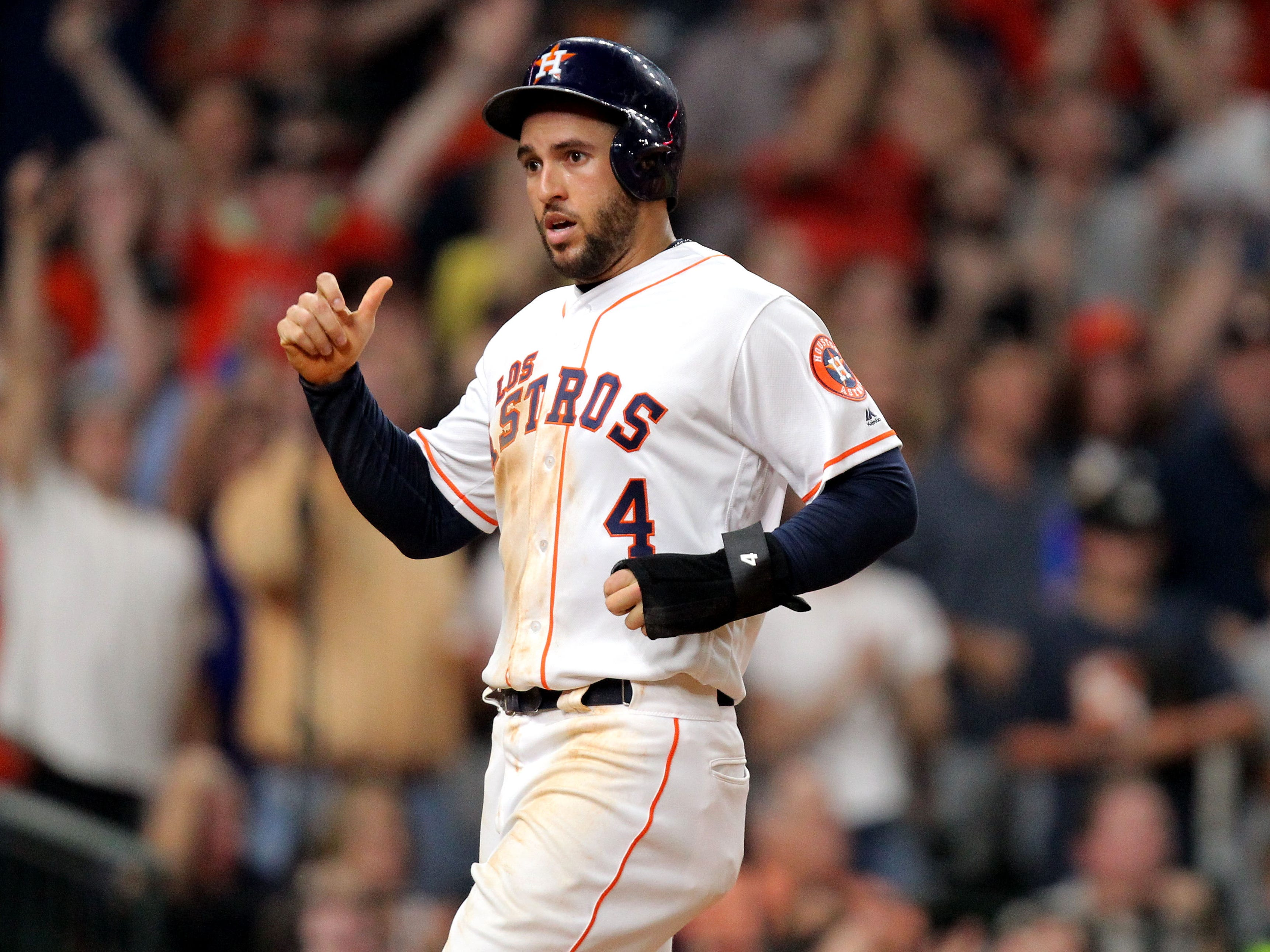 Sep 15, 2018; Houston, TX, USA; Houston Astros center fielder George Springer (4) crosses home plate to score a run against the Arizona Diamondbacks during the sixth inning at Minute Maid Park. Mandatory Credit: Erik Williams-USA TODAY Sports