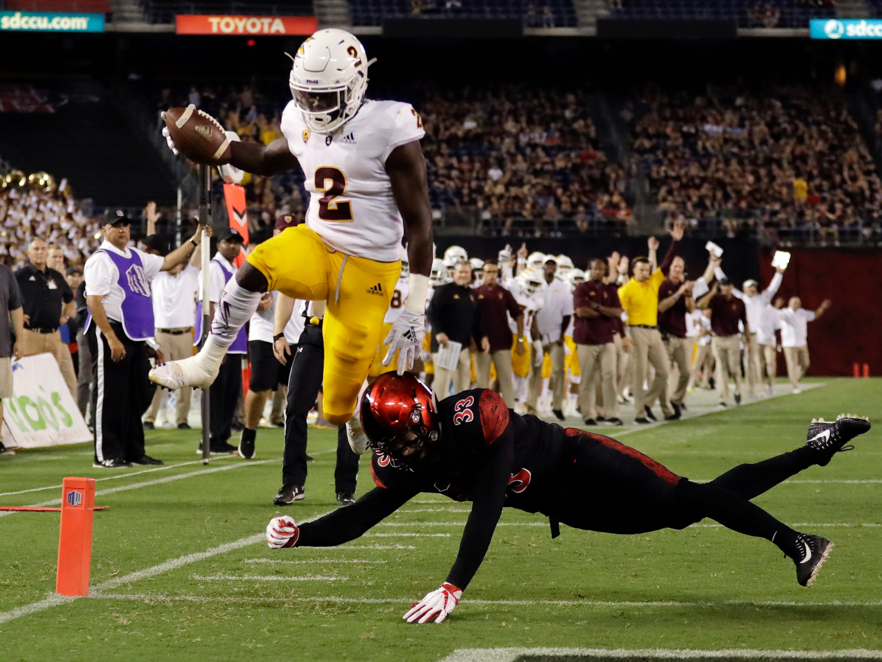 Arizona State wide receiver Brandon Aiyuk (2) goes over San Diego State safety Parker Baldwin (33) to score a touchdown during the first half of an NCAA college football game, Saturday, Sept. 15, 2018, in San Diego. (AP Photo/Gregory Bull)