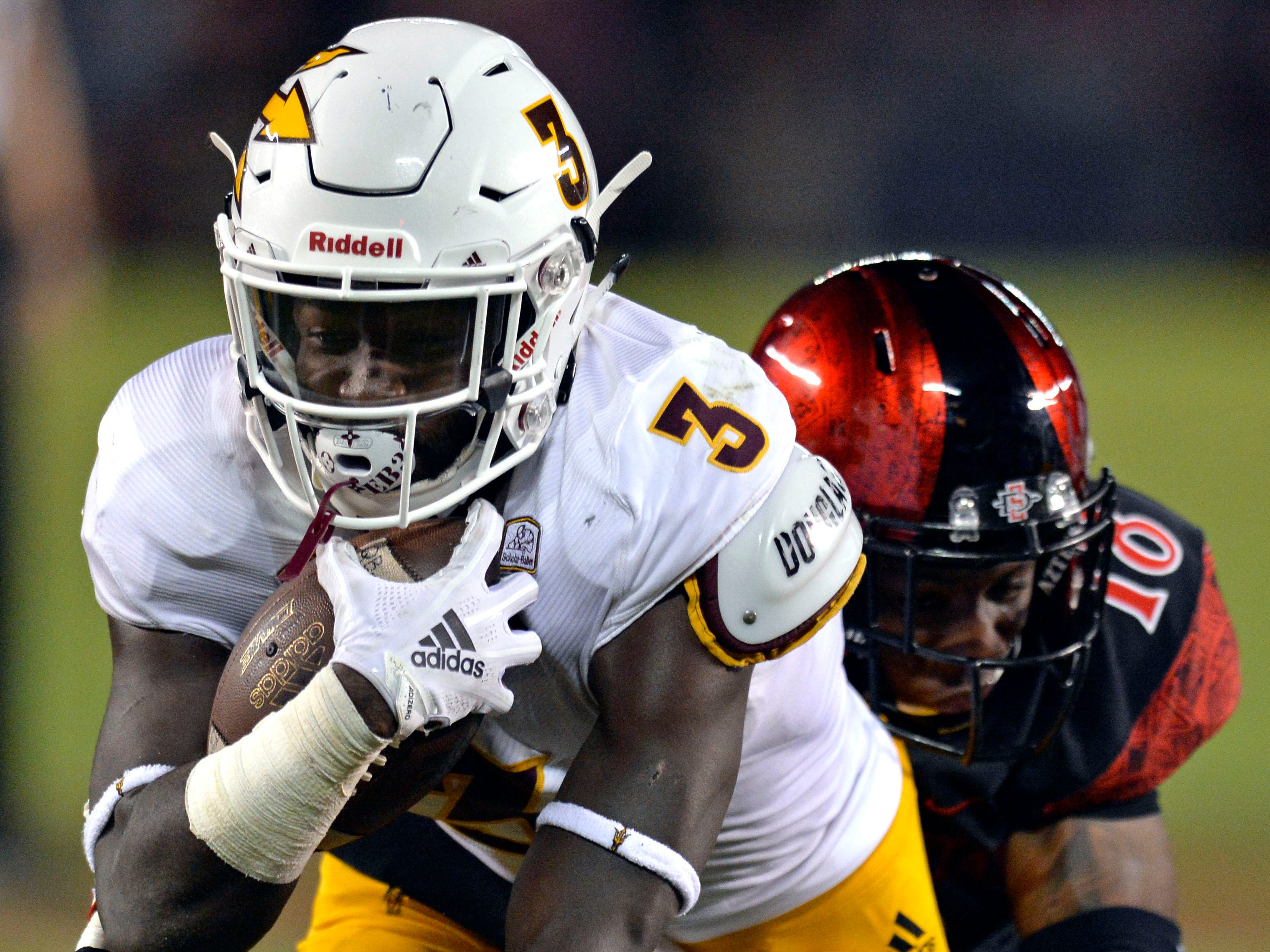 Sep 15, 2018; San Diego, CA, USA; Arizona State Sun Devils running back Eno Benjamin (3) runs against San Diego State Aztecs safety Trenton Thompson (18) during the second quarter at SDCCU Stadium. Mandatory Credit: Jake Roth-USA TODAY Sports