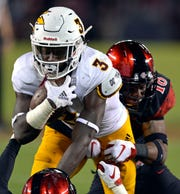 Arizona State Sun Devils running back Eno Benjamin (3) runs against San Diego State Aztecs safety Trenton Thompson (18) during the second quarter at SDCCU Stadium.  Jake Roth-USA TODAY Sports
