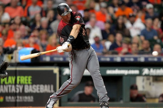 Sep 15, 2018; Houston, TX, USA; Arizona Diamondbacks first baseman Paul Goldschmidt (44) hits a single to center field against the Houston Astros during the sixth inning at Minute Maid Park. Mandatory Credit: Erik Williams-USA TODAY Sports