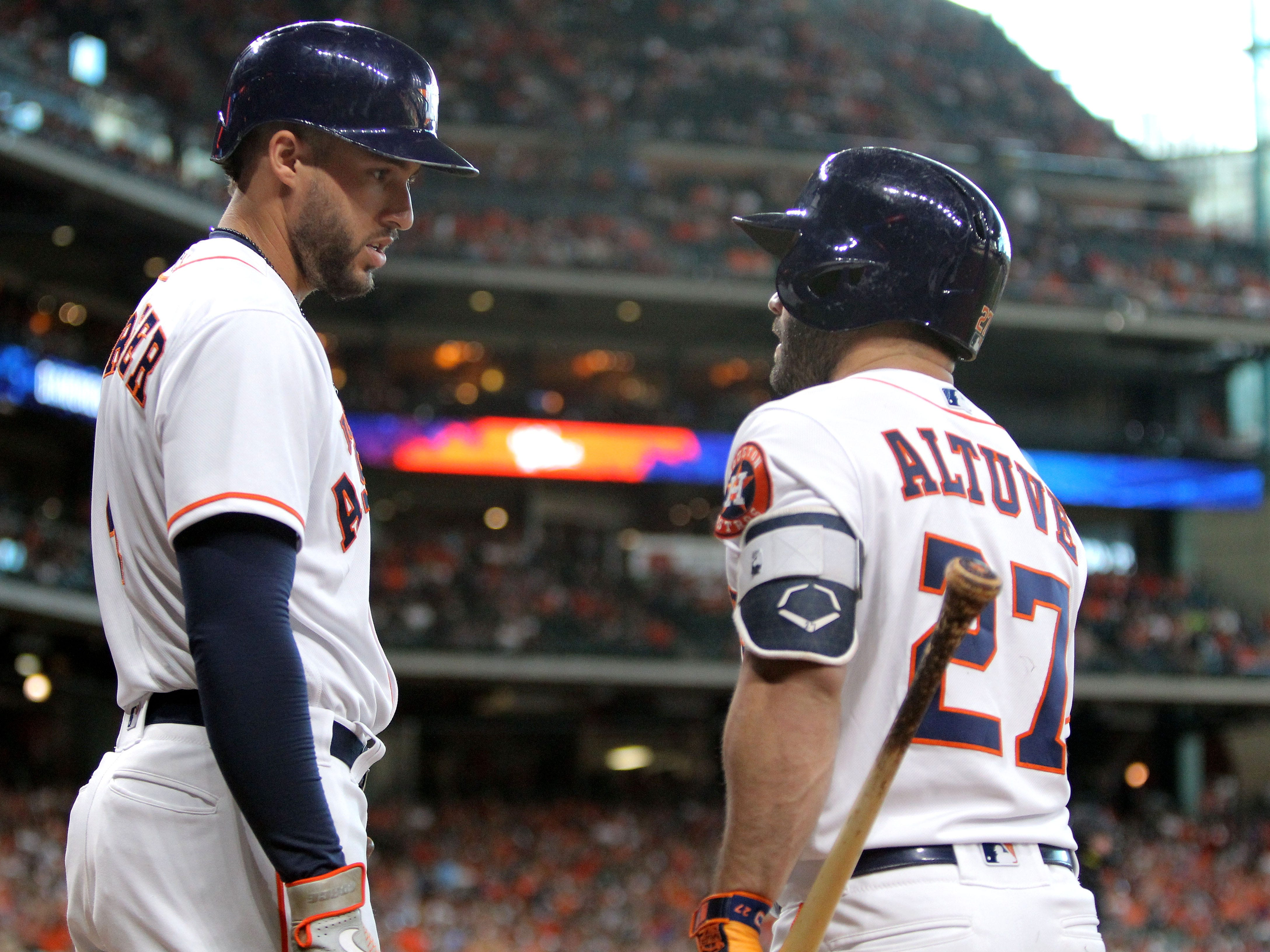 Sep 15, 2018; Houston, TX, USA; Houston Astros center fielder George Springer (4, left) talks with Houston Astros second baseman Jose Altuve (27) during the first inning against the Arizona Diamondbacks at Minute Maid Park. Mandatory Credit: Erik Williams-USA TODAY Sports