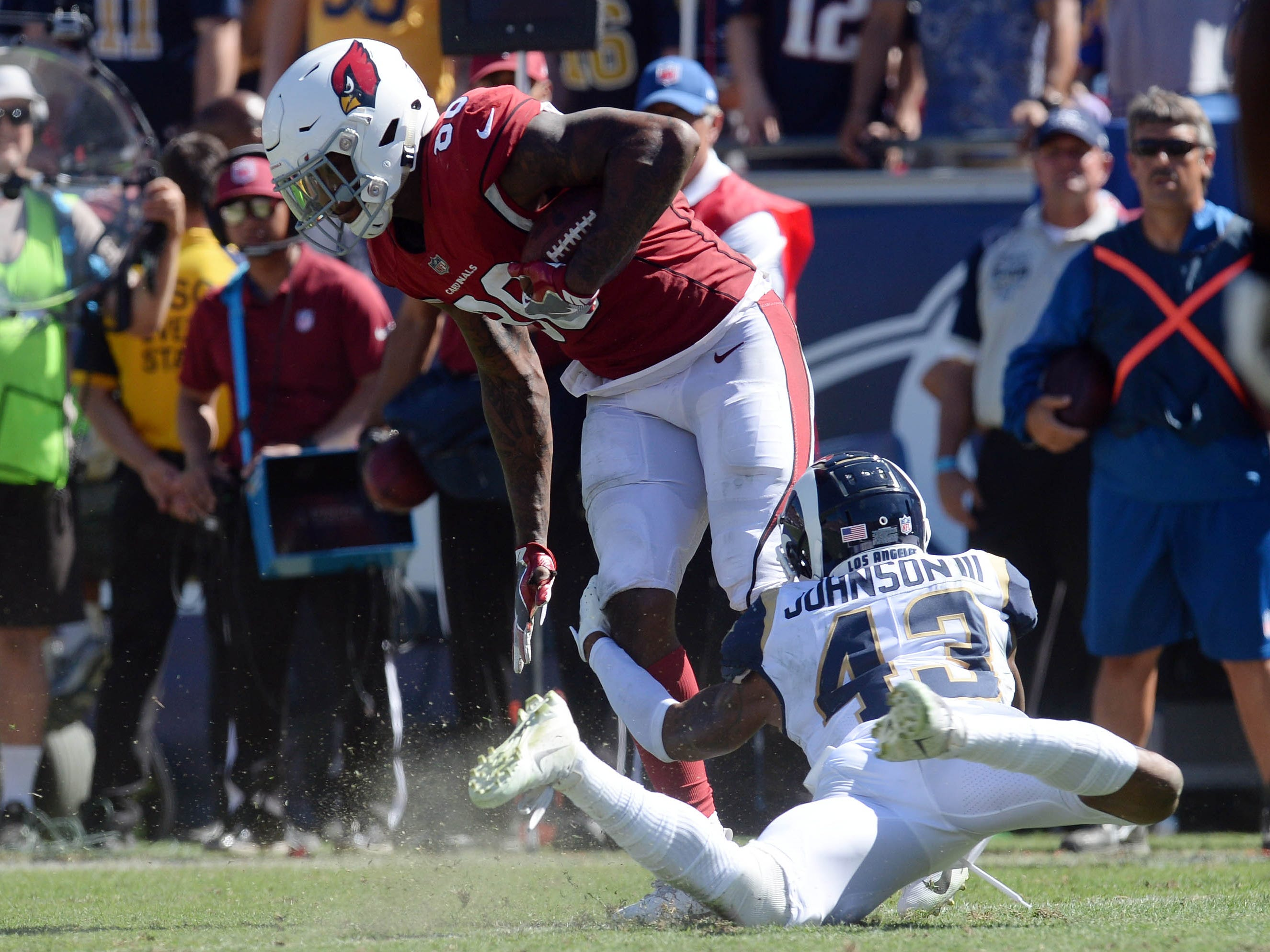 September 16, 2018; Los Angeles, CA, USA; Arizona Cardinals tight end Ricky Seals-Jones (86) is brought down by Los Angeles Rams defensive back John Johnson (43) during the second half at the Los Angeles Memorial Coliseum. Mandatory Credit: Gary A. Vasquez-USA TODAY Sports