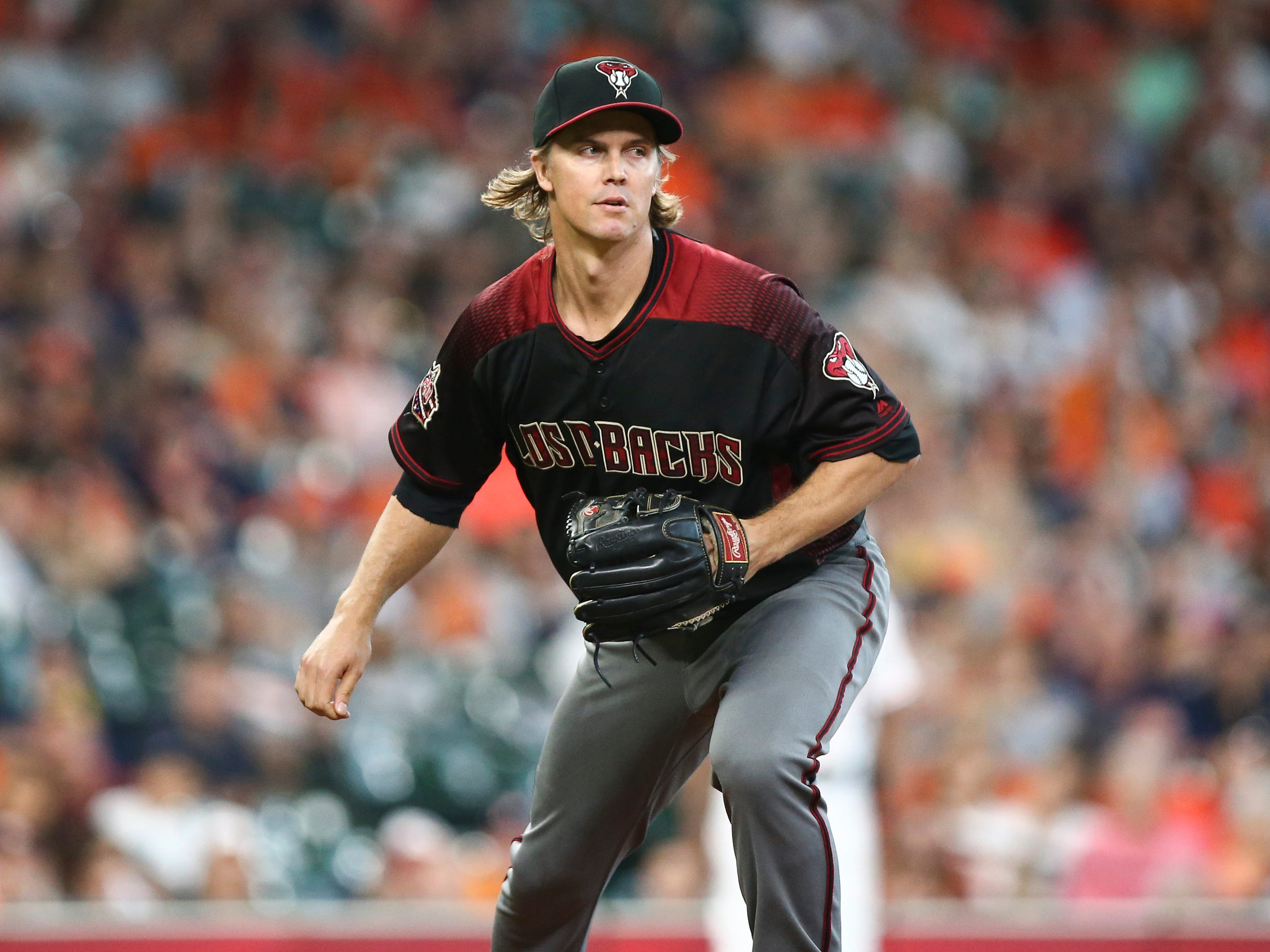 Sep 16, 2018; Houston, TX, USA; Arizona Diamondbacks starting pitcher Zack Greinke (21) reacts after a pitch during the first inning against the Houston Astros at Minute Maid Park. Mandatory Credit: Troy Taormina-USA TODAY Sports